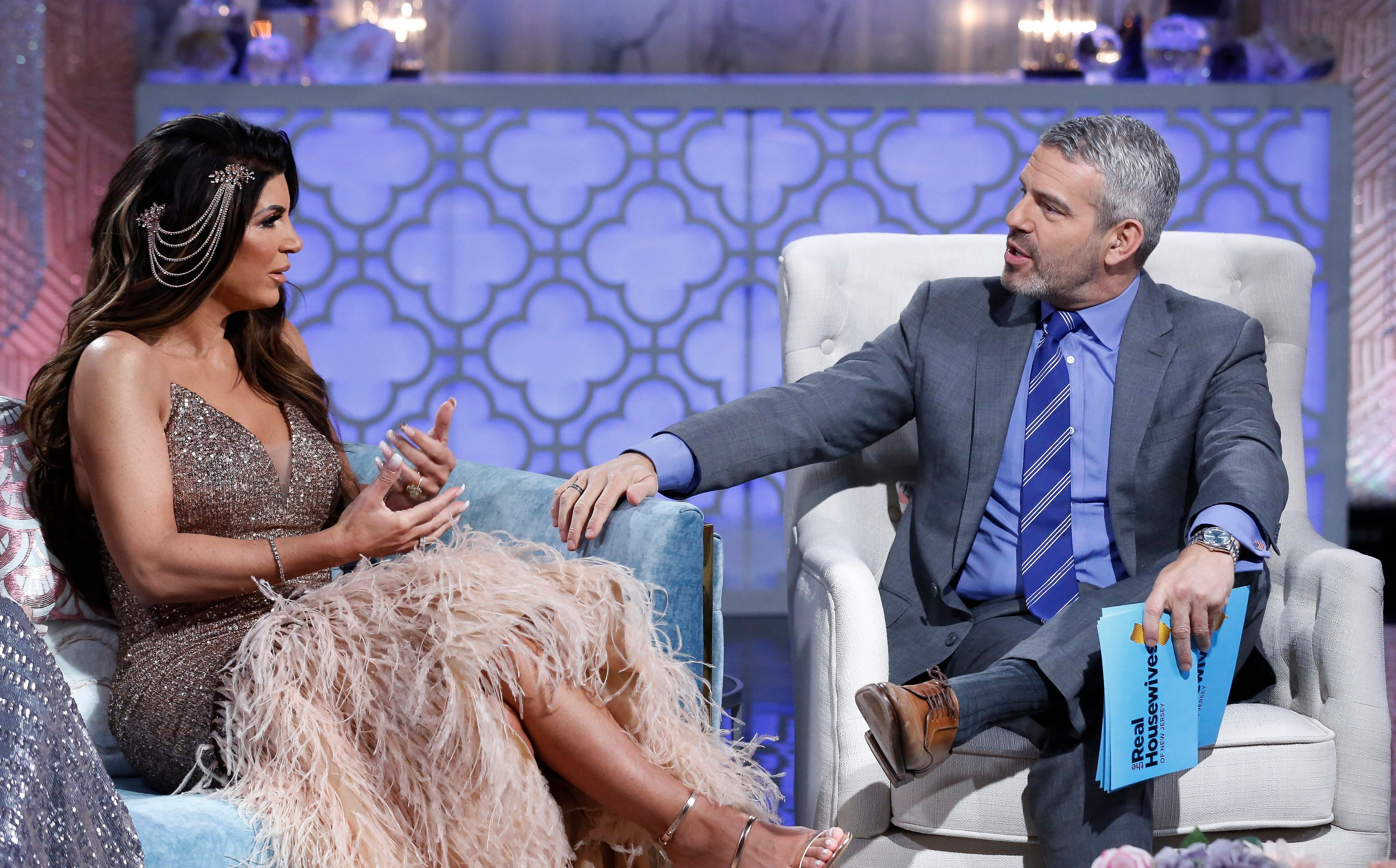 Andy Cohen shares a moment with Teresa Giudice.