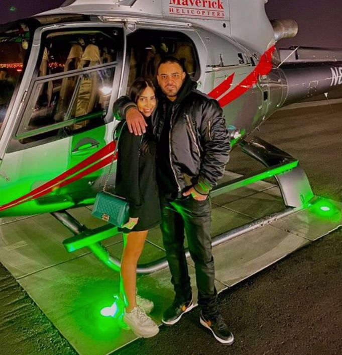 Mike Shouhed and Paulina Ben-Cohen in front of helicopter.