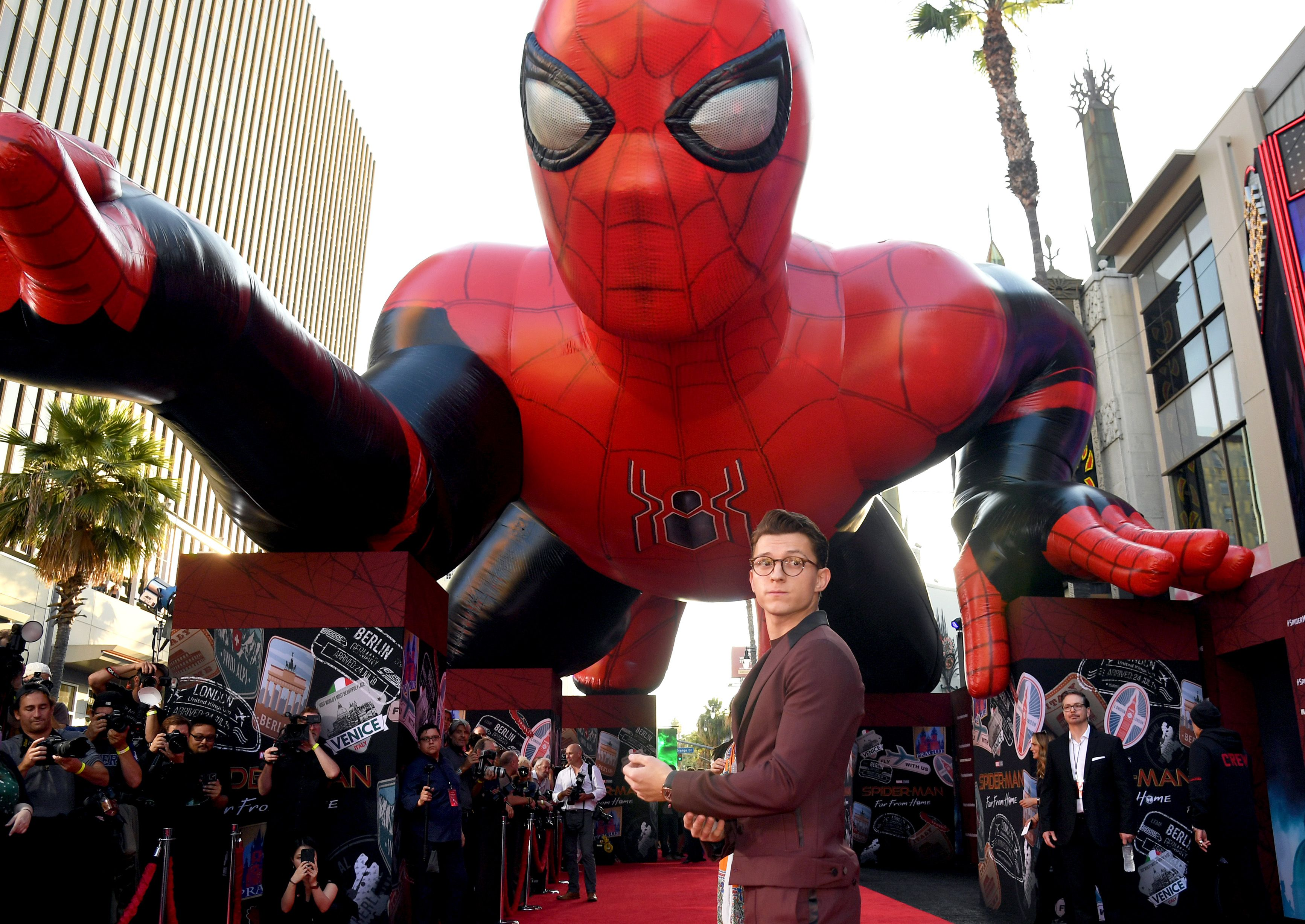 Tom Holland with a Spider-Man float