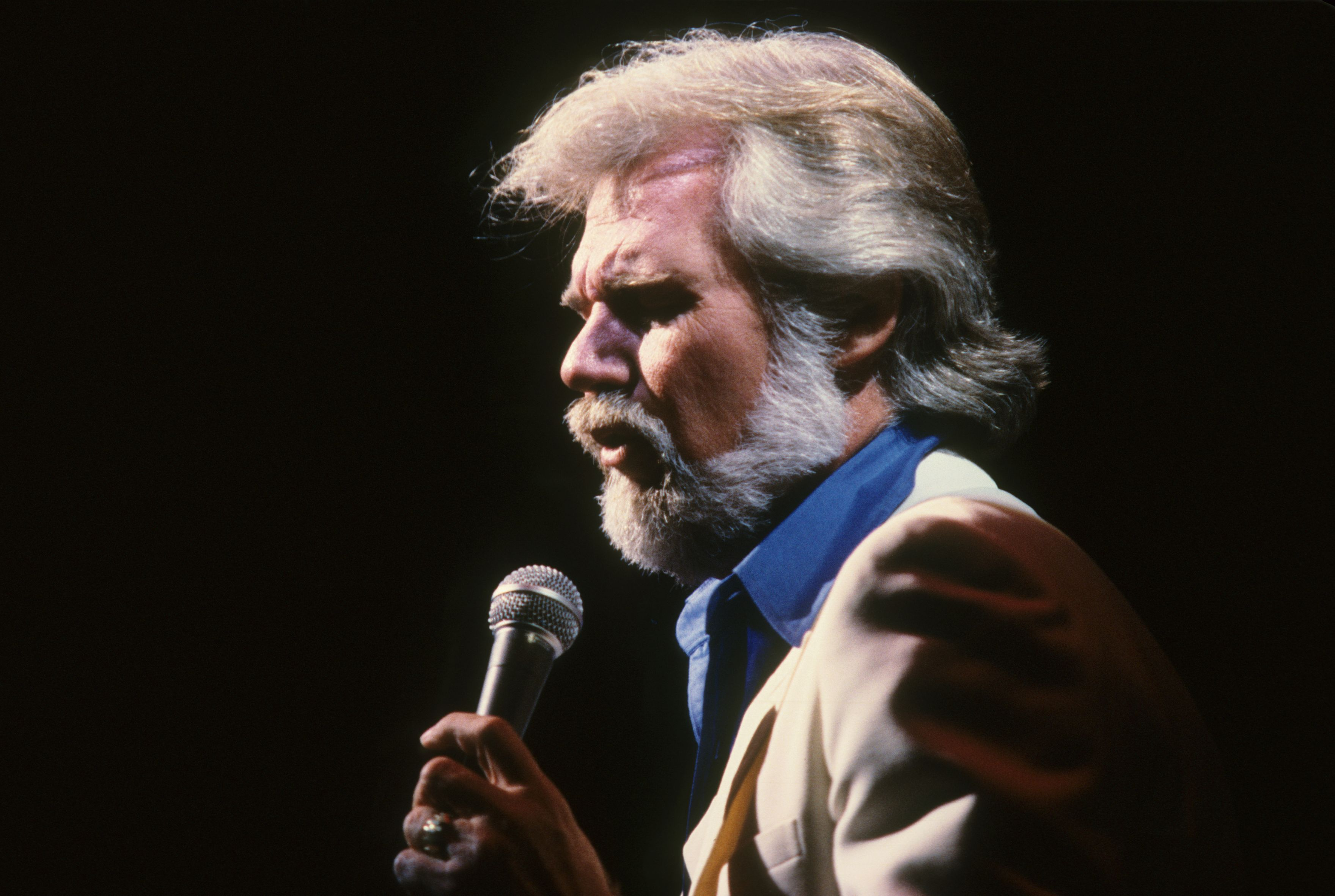 The late Kenny Rogers during a performance.