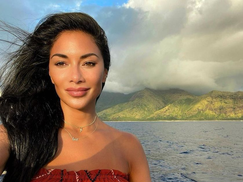 Nicole Scherzinger poses in a strapless look in front of a breathtaking view.
