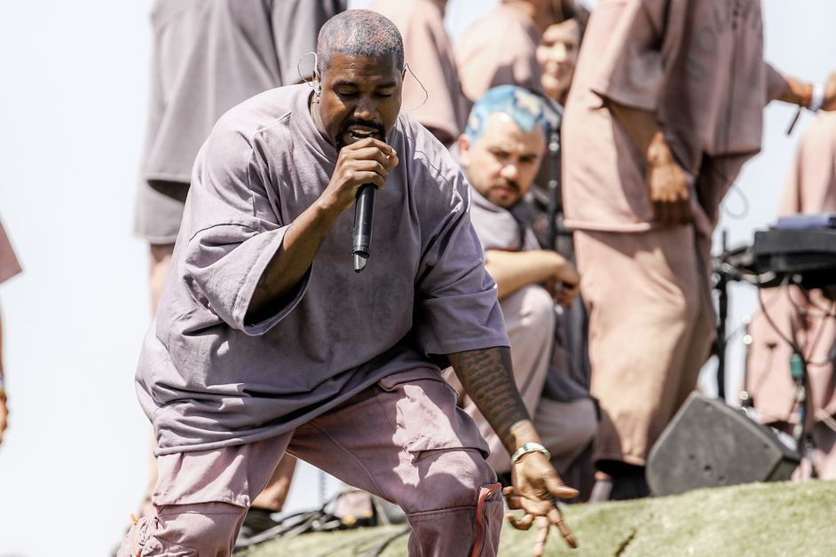 Kanye West performs at an event.