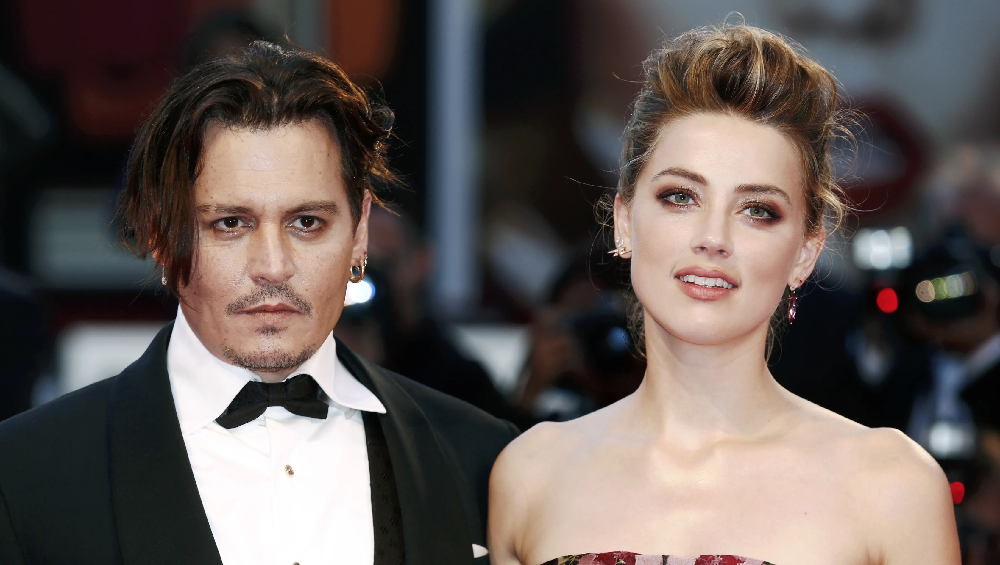Johnny Depp and Amber Heard on red carpet years ago