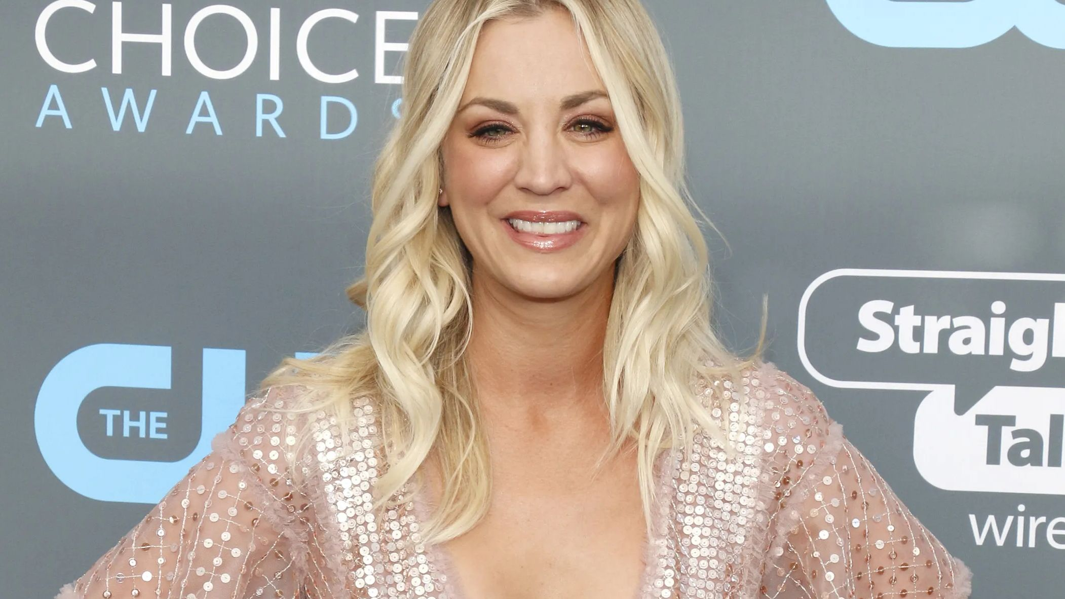 Kaley Cuoco smiles at an event