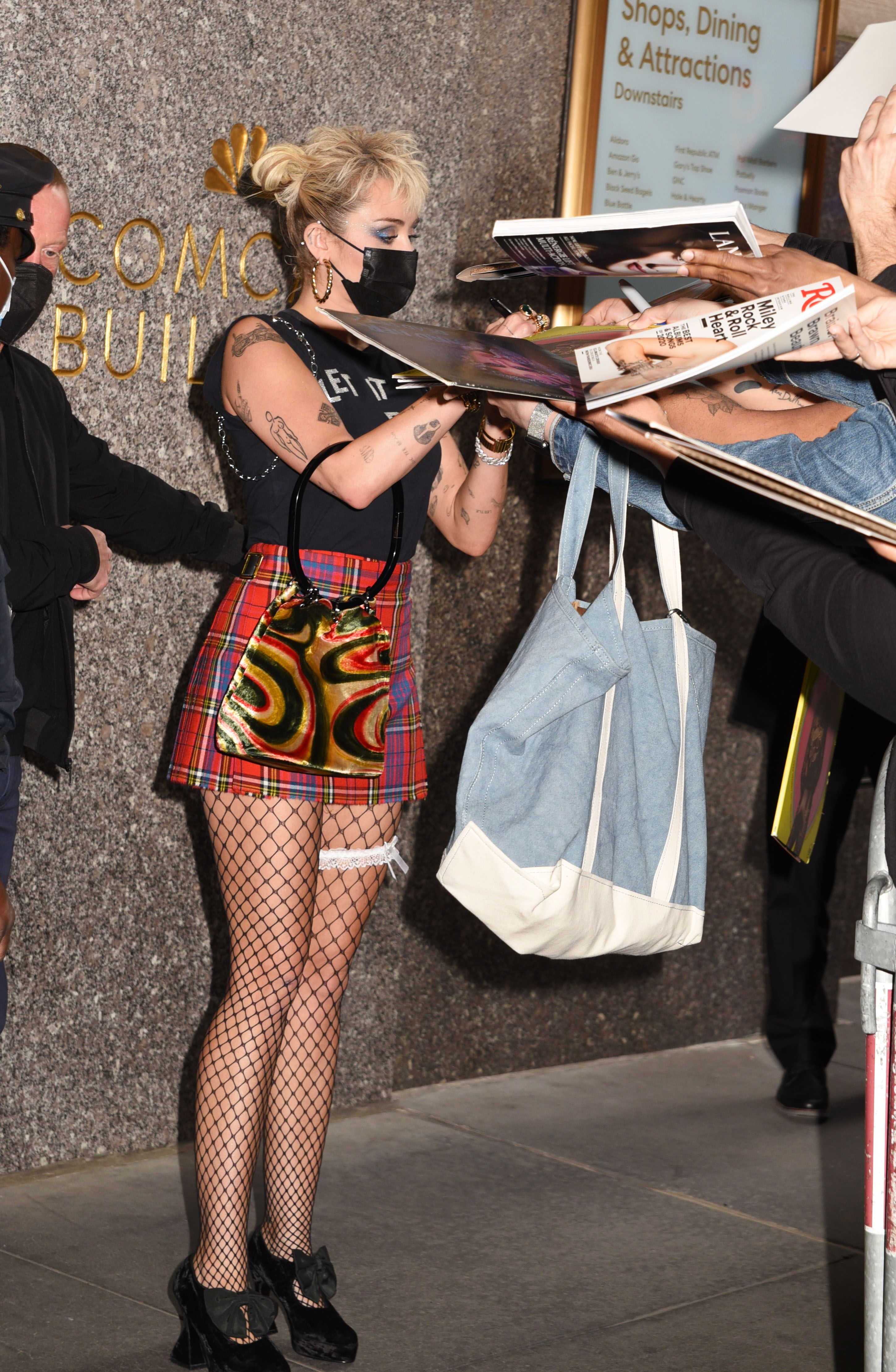 Miley Cyrus in fishnets in the street