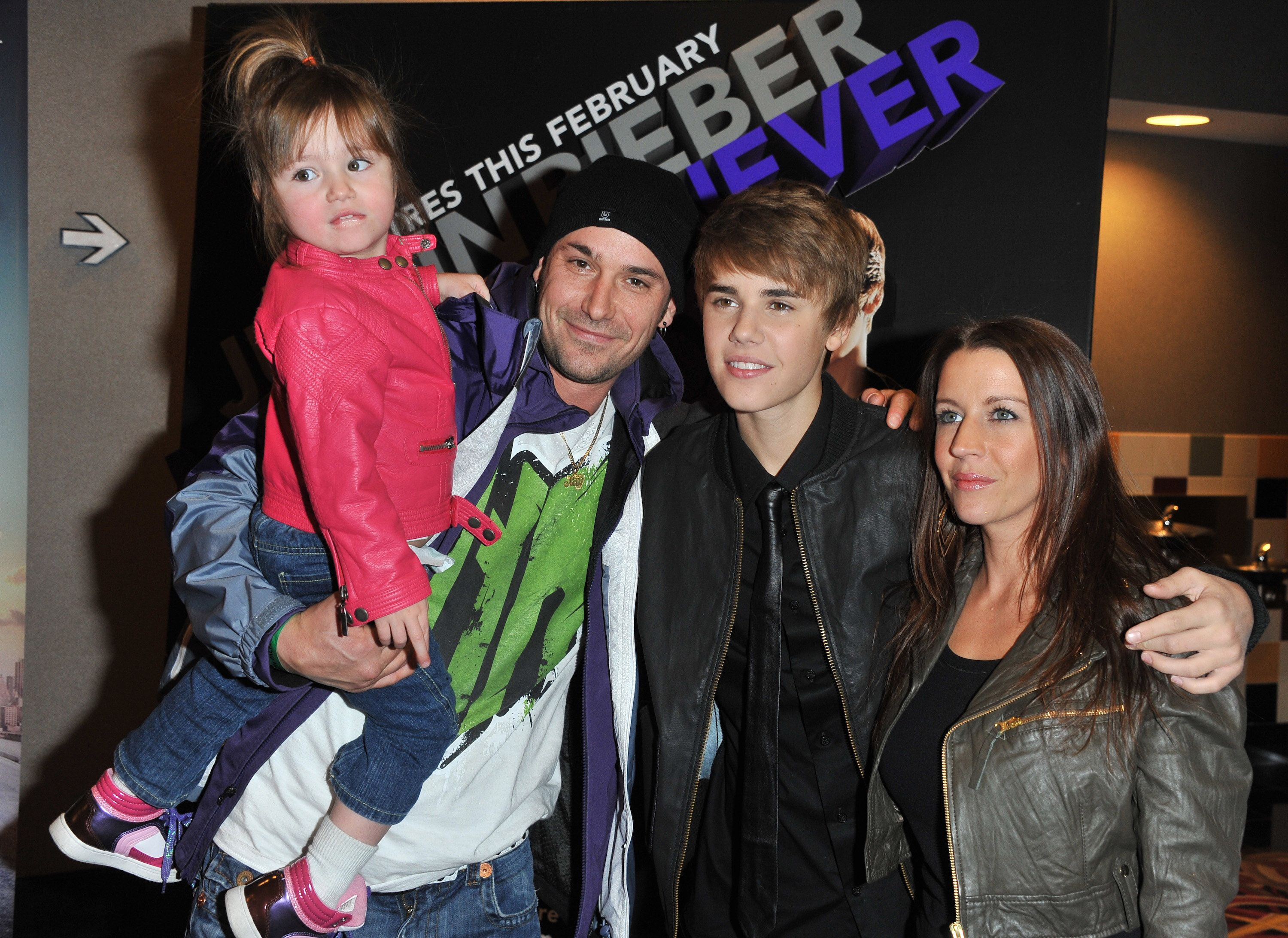 Justin Bieber with his parents and youngest sister.