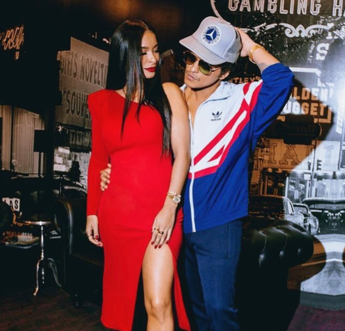 Jessica Caban and Bruno Mars posing together.