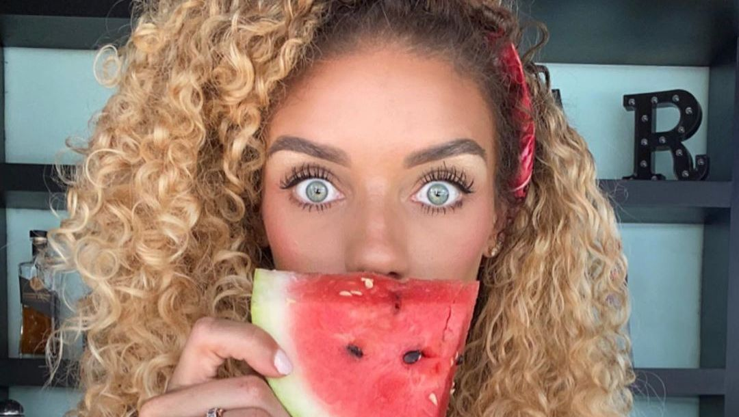 Jena Frumes poses with watermelon