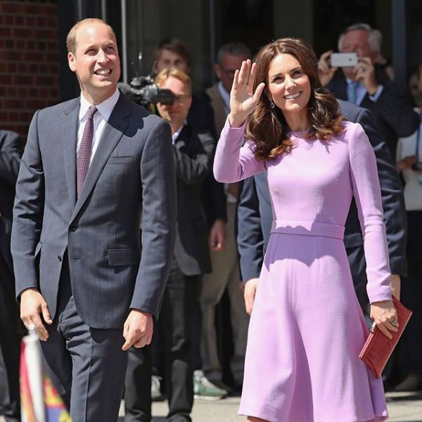 Prince William walking with Kate Middleton as she waves at onlookers
