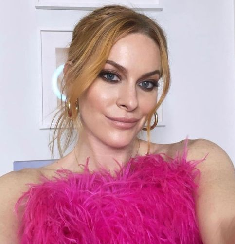 Leah McSweeney wears a pink feathered dress.