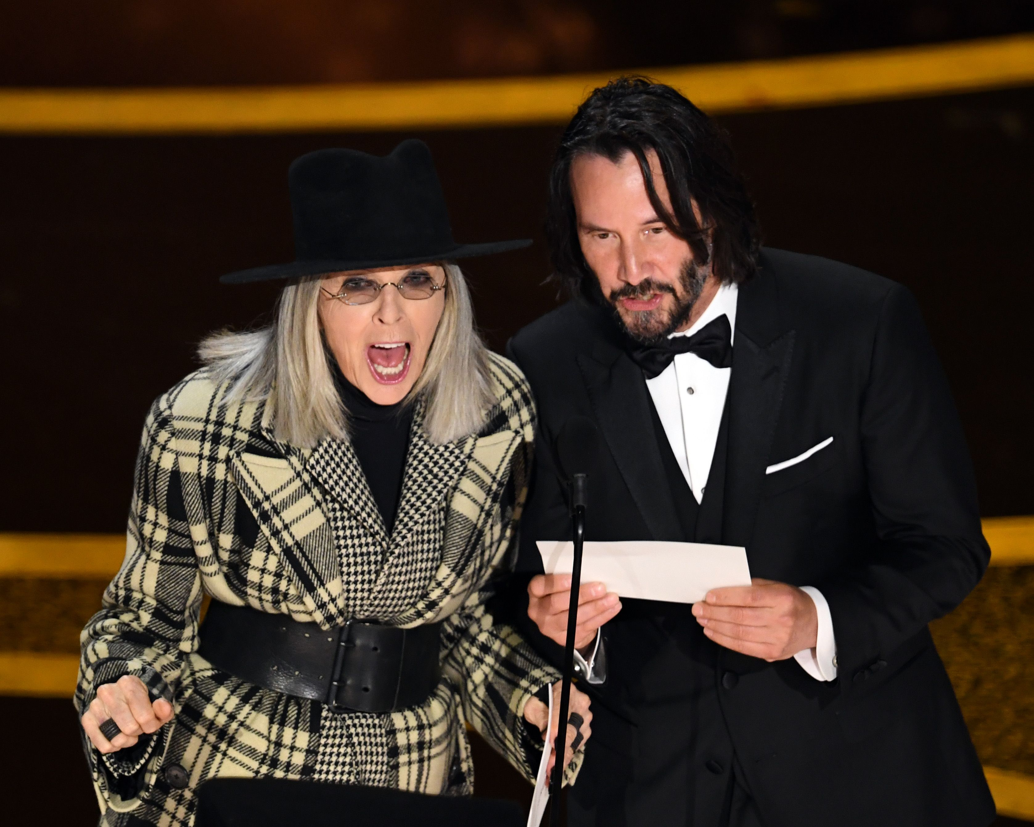 Diane Keaton and Keanu Reeves on the Oscars stage.