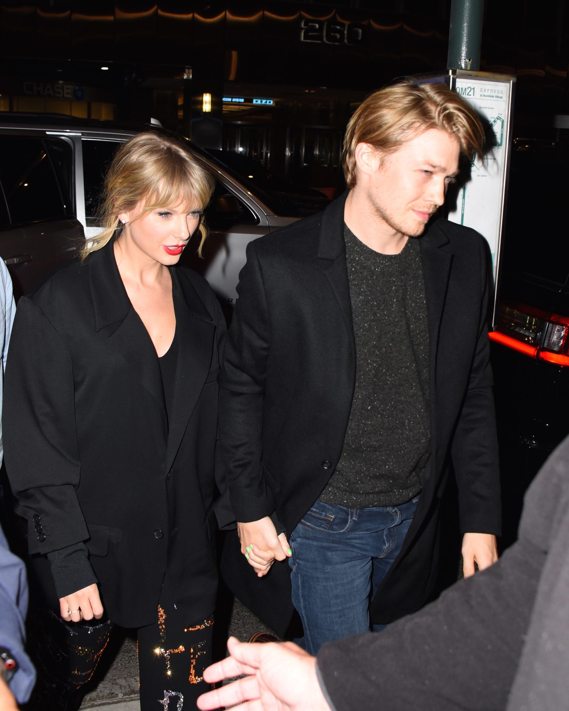 Taylor Swift and Joe Alwyn holding hands