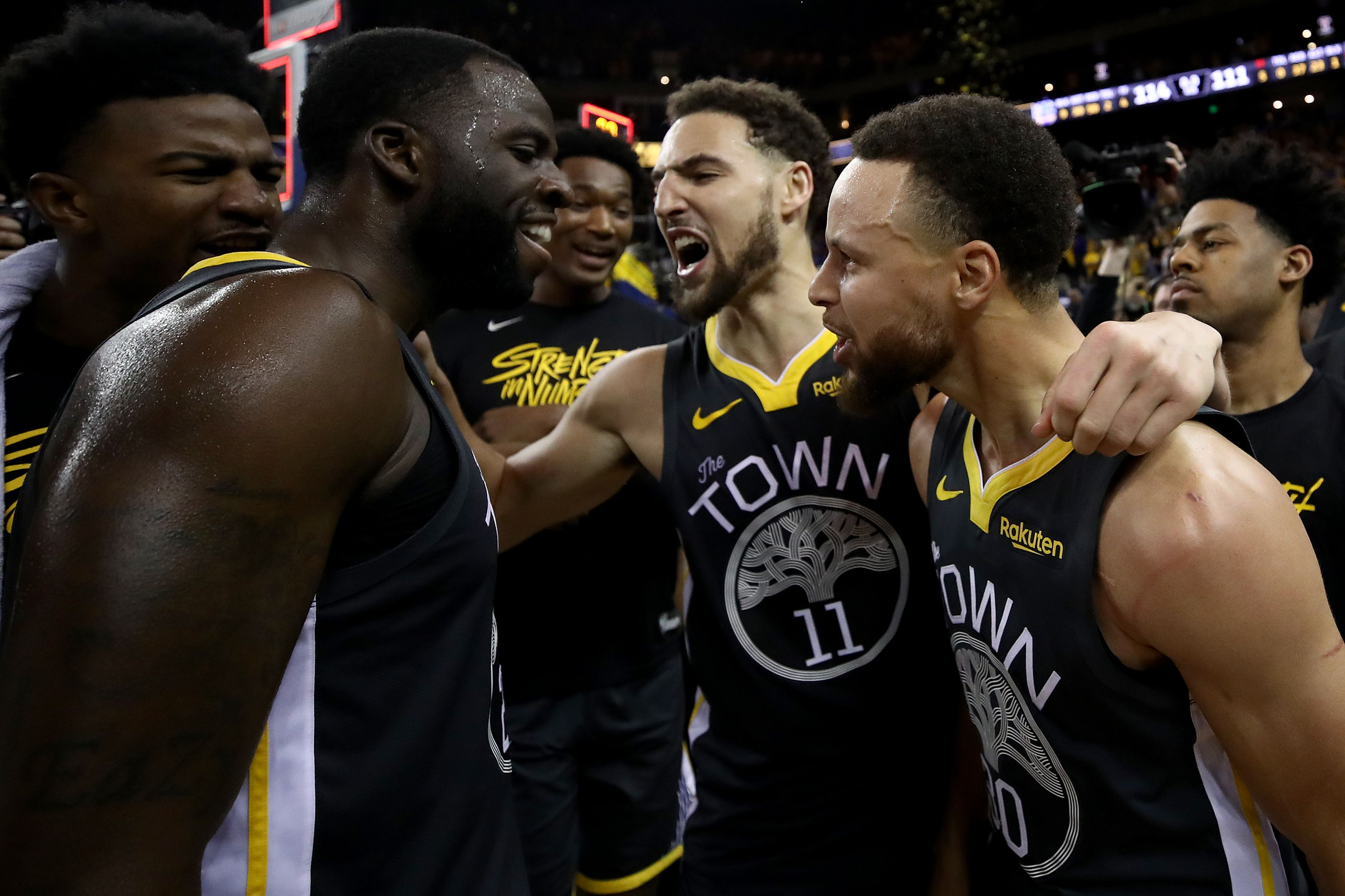 Stephen Curry, Klay Thompson, and Draymond Green celebrating Warriors' victory