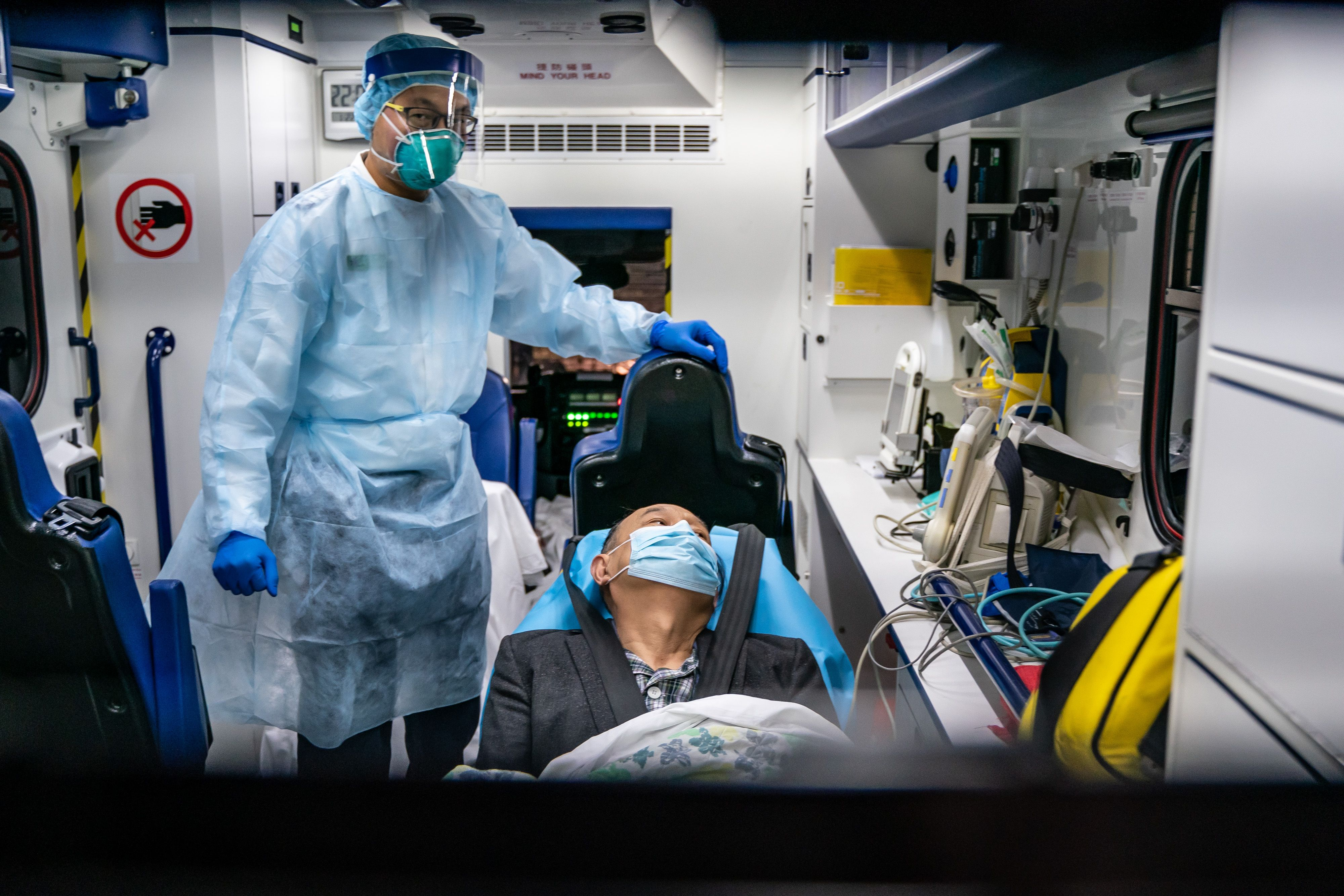 Patient being treated by man in HASMAT suit