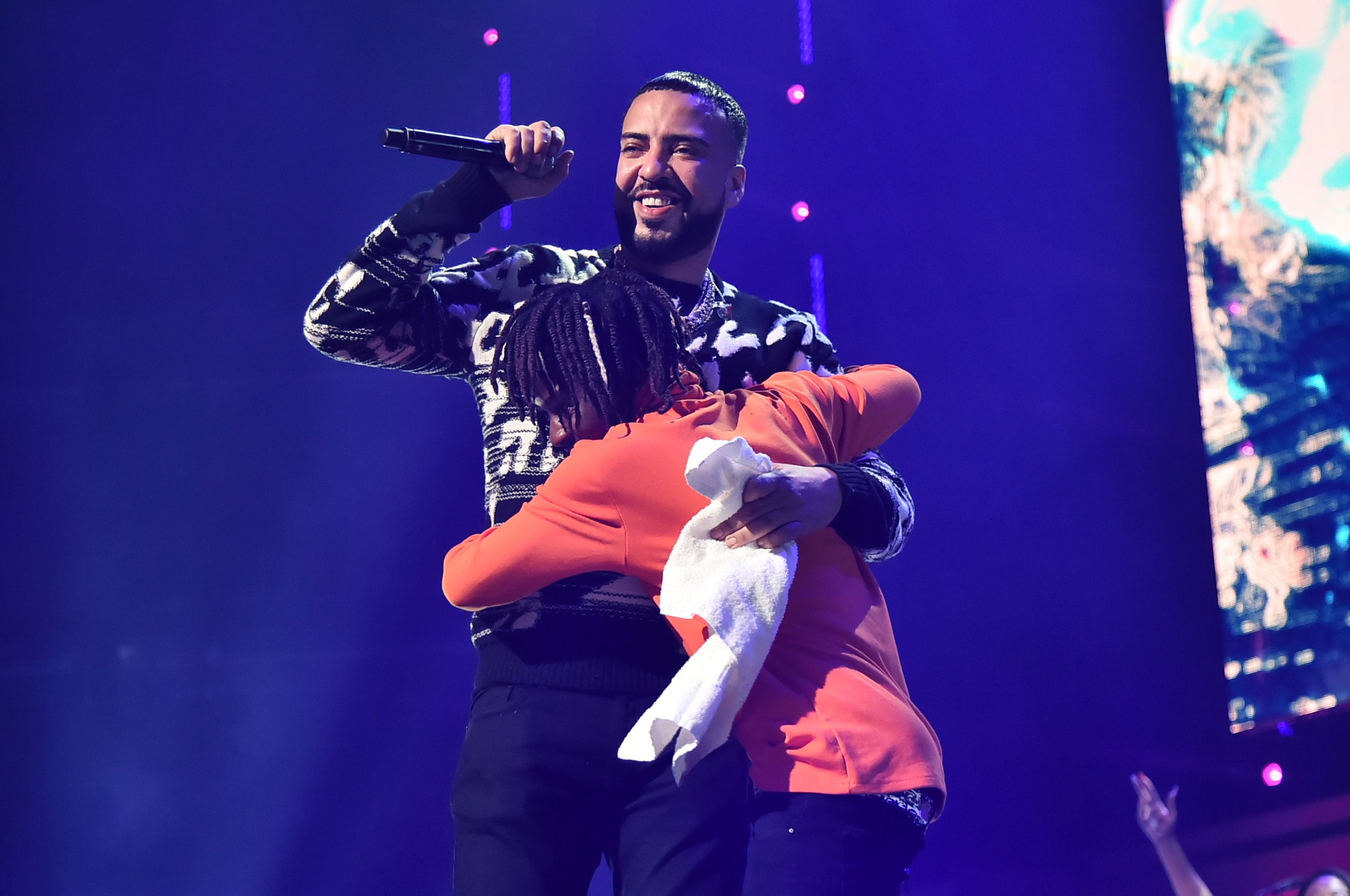 French Montana Hugging Someone on stage