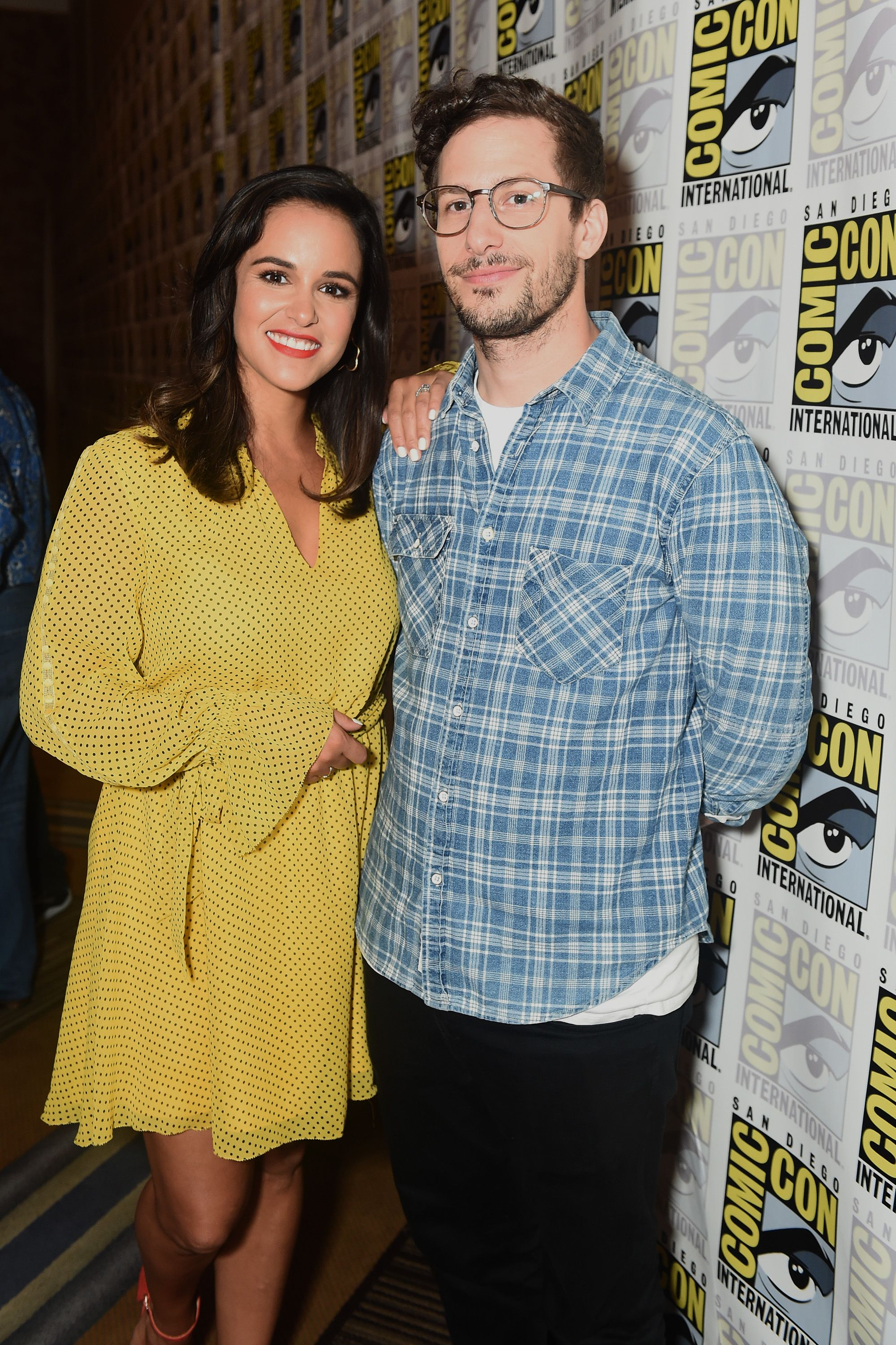TV couple Amy and Jake standing together for a photo at an event.