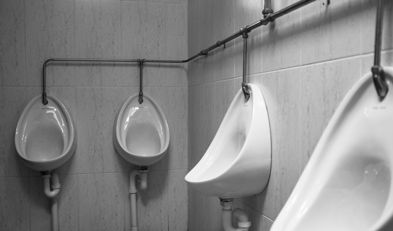 Urinals in a bathroom.