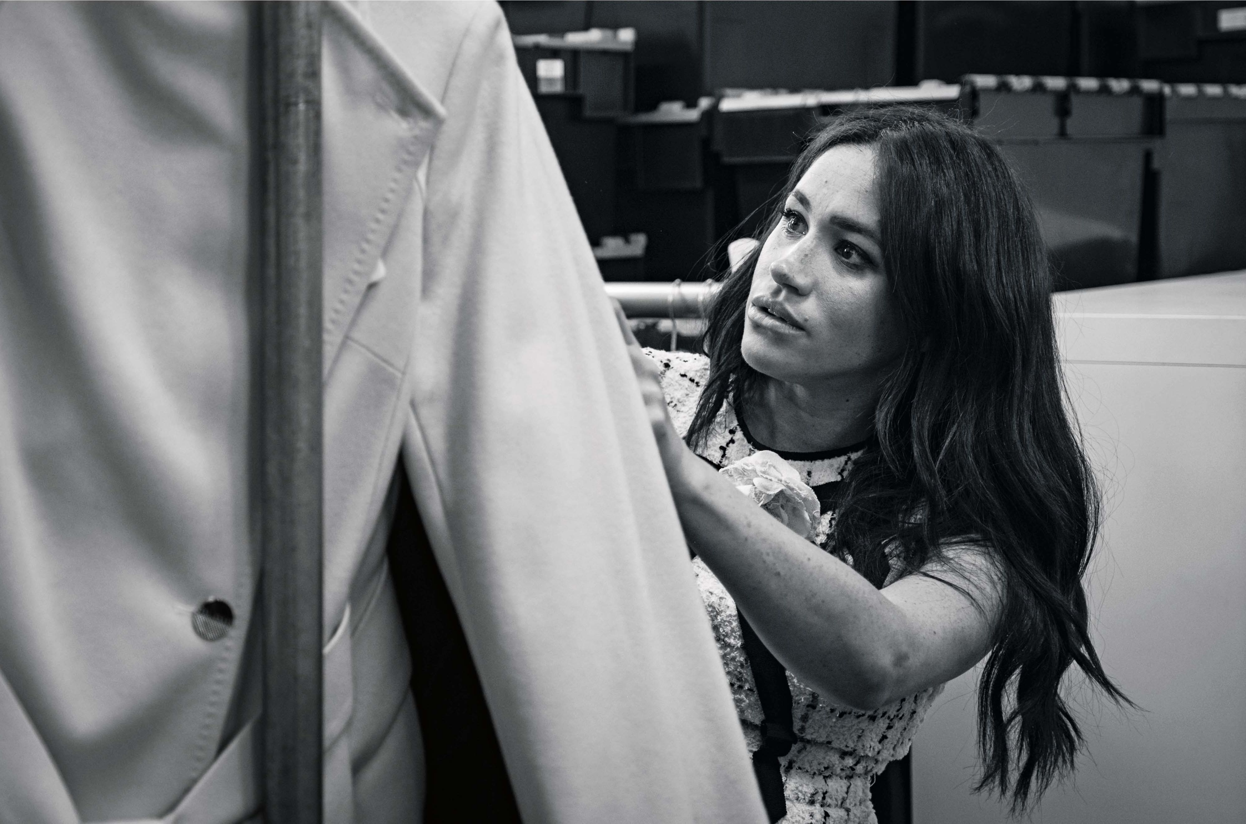 Meghan Markle looking through clothing
