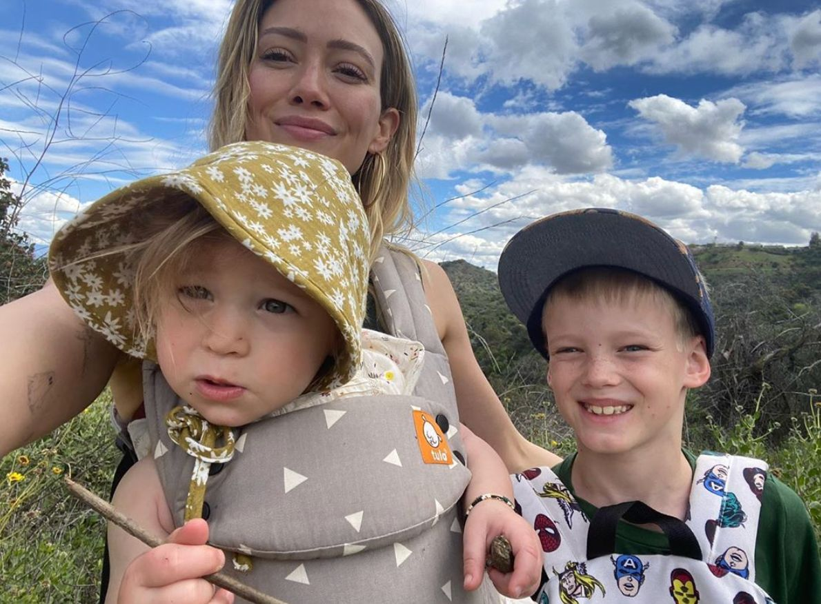 Lizzie McGuire taking a selfie with her two children.