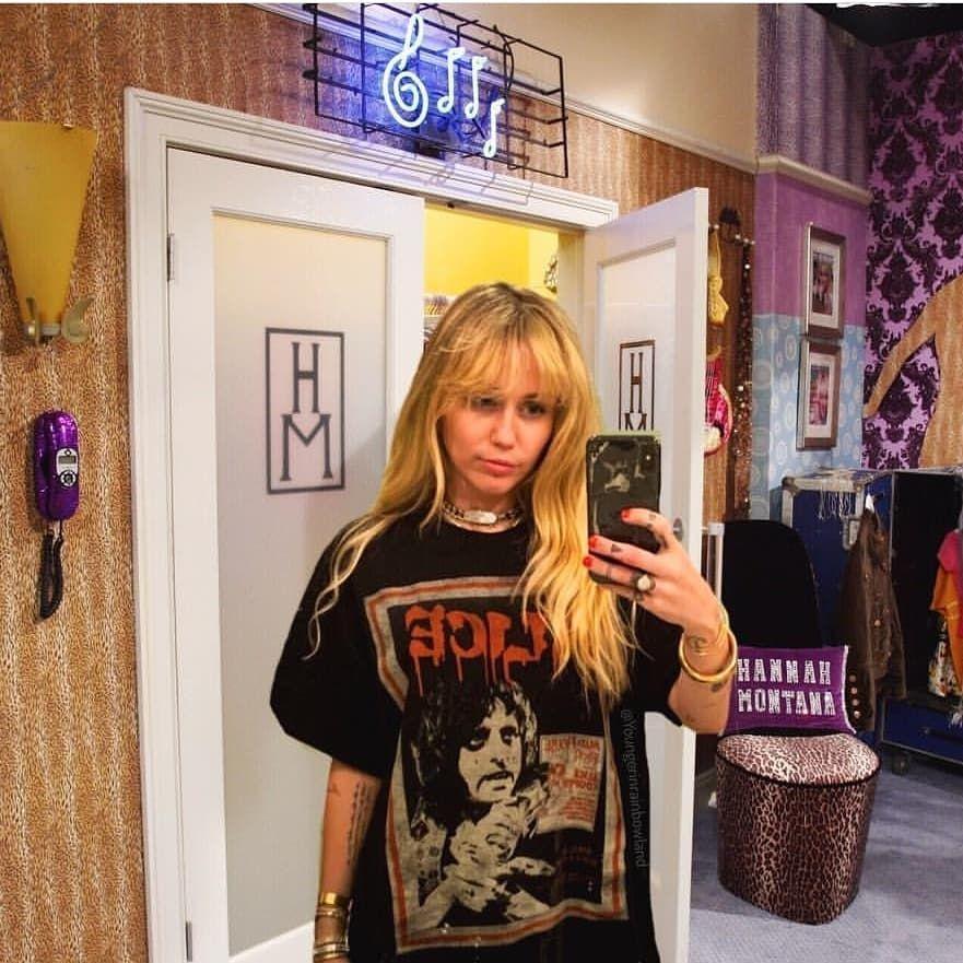 Miley Cyrus selfie in large tee