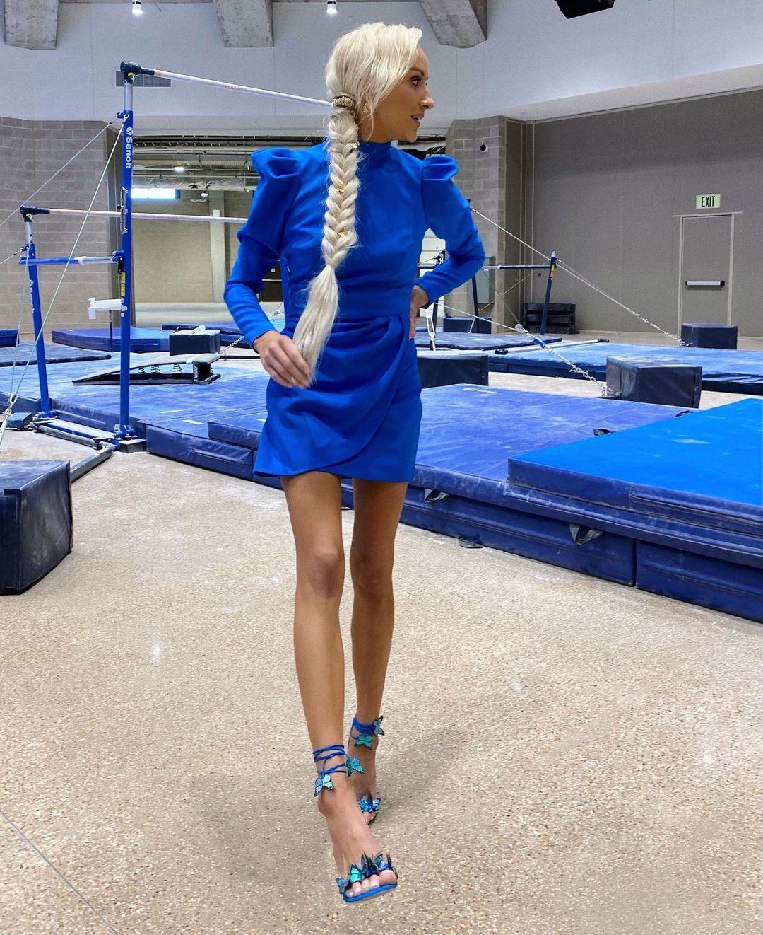 Nastia Liukin indoors in short dress