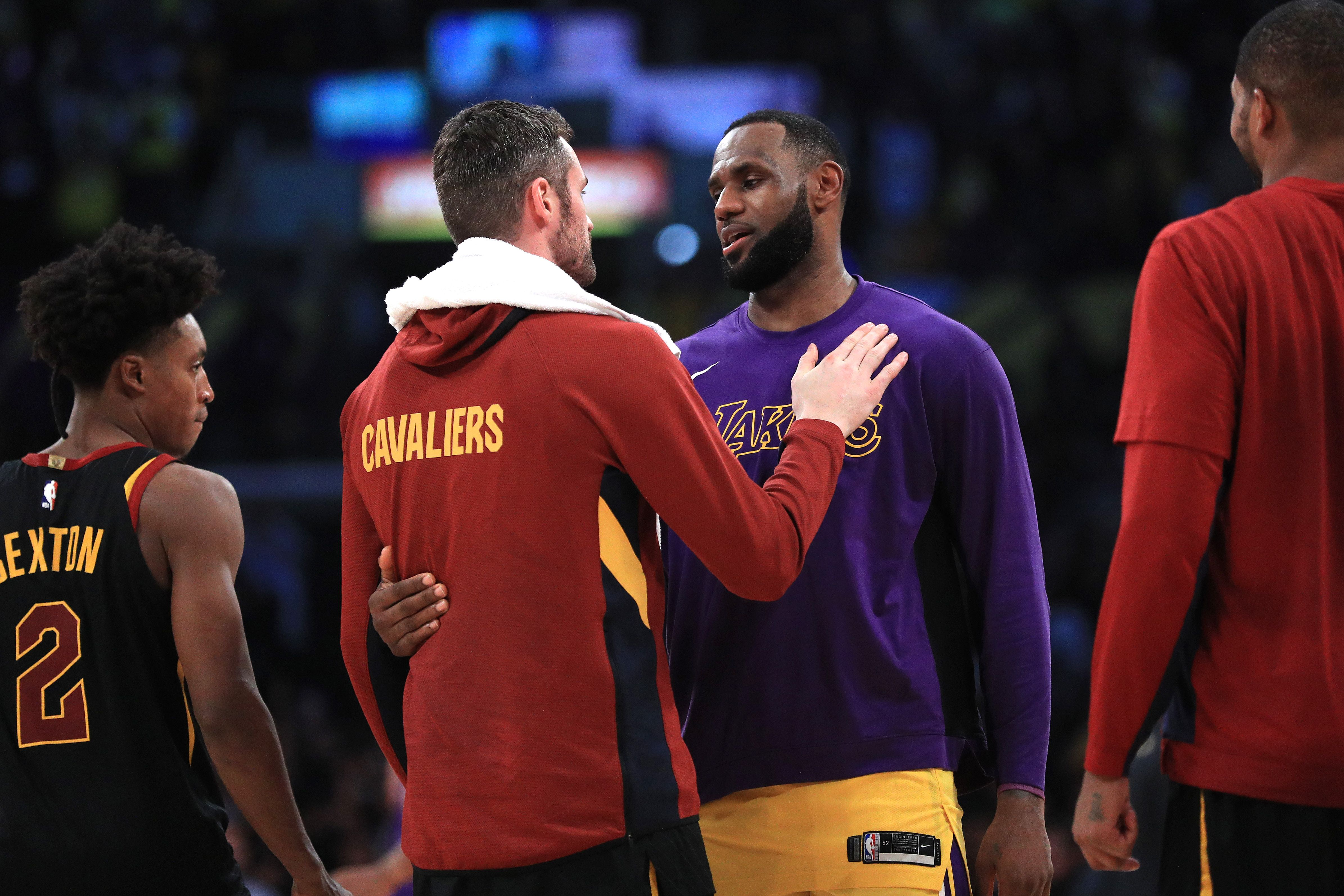 Kevin Love talks with former teammate LeBron James after the game