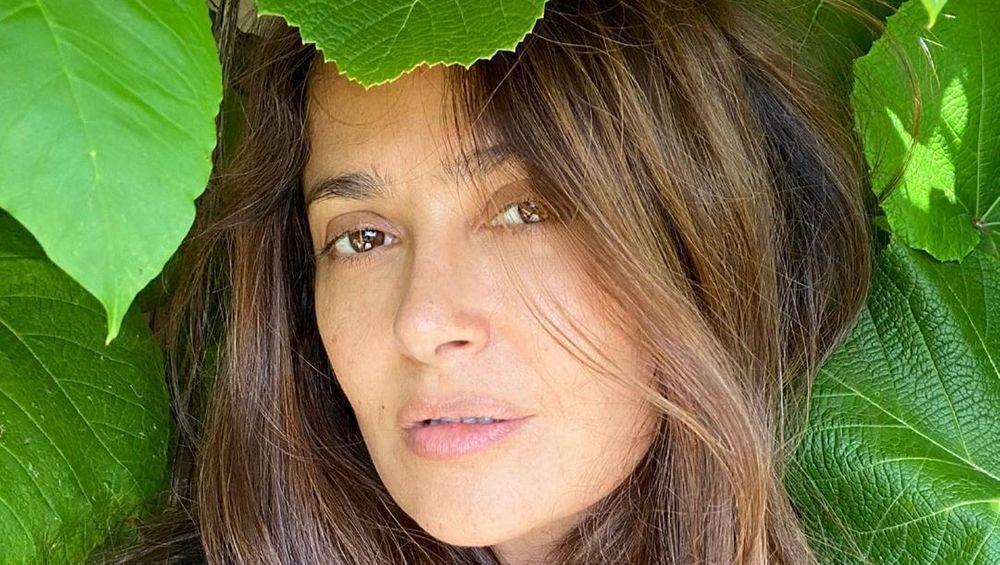 Salma Hayek poses amid leaves