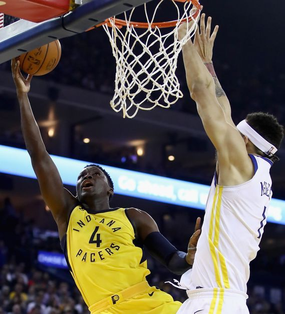 JaVale McGee trying to block Victor Oladipo