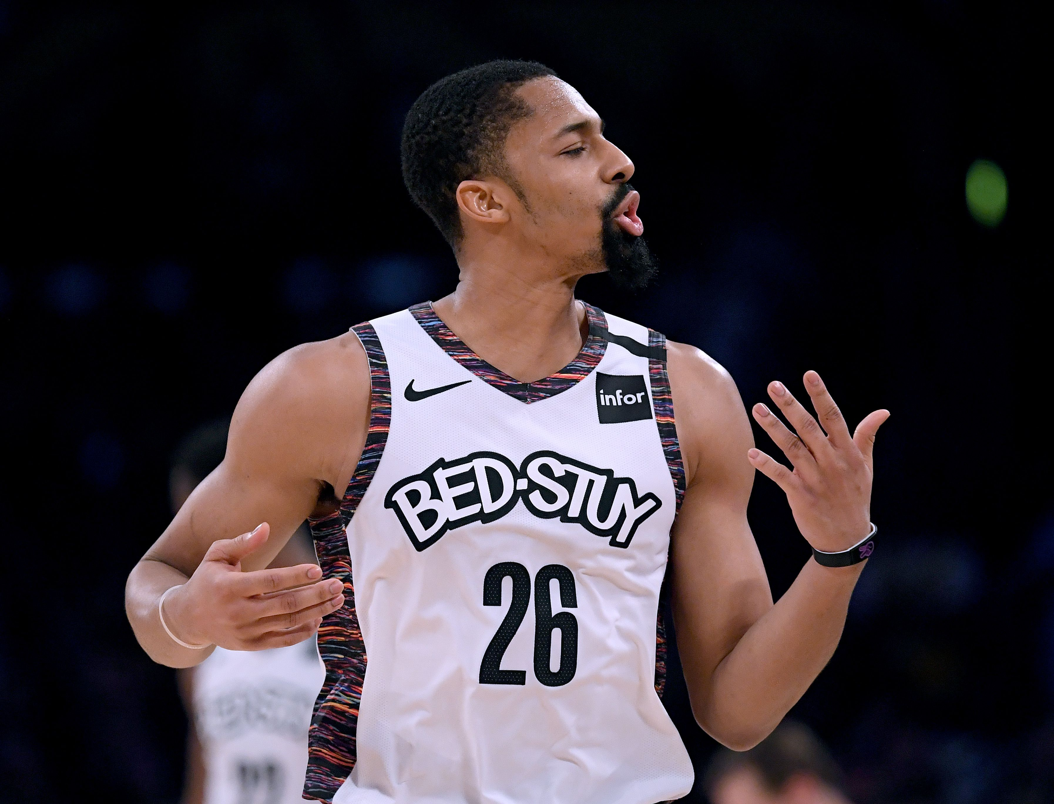 Spencer Dinwiddie complains to the ref