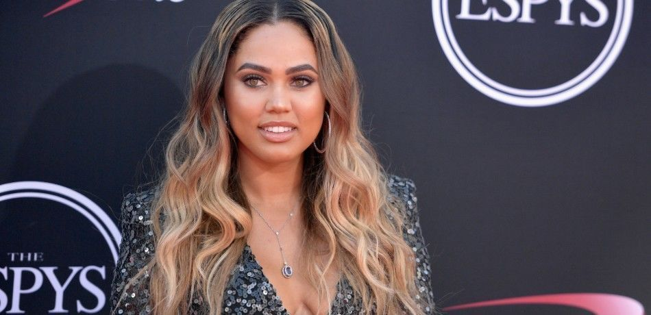 Ayesha Curry poses at an event