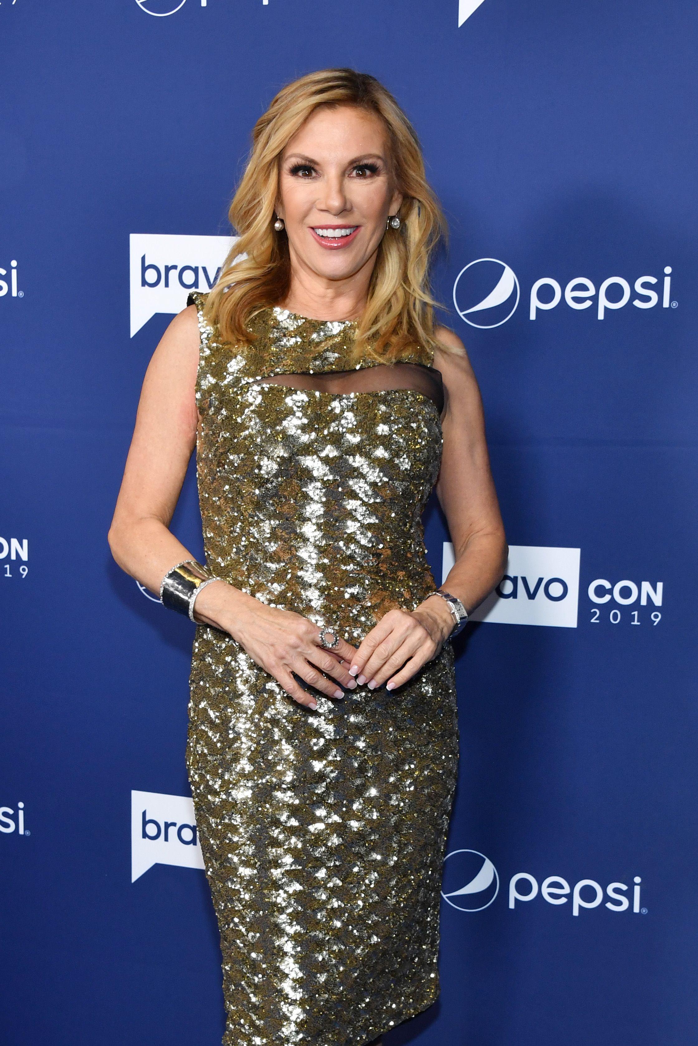 Ramona Singer wears a metallic dress.