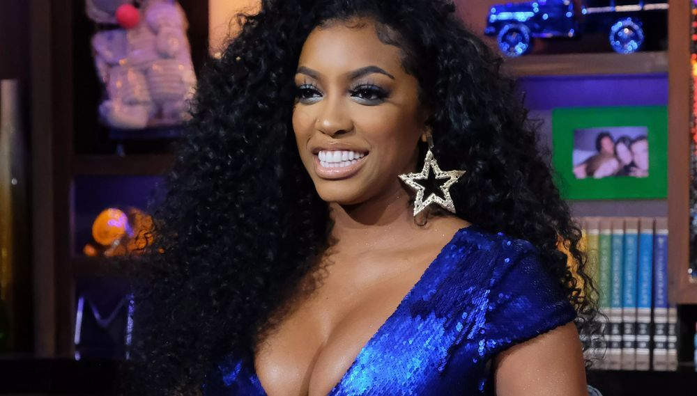 Porsha Williams leaves nothing to imagination in this photo as she looks stunning in this blue sequence design v-neck outfit.