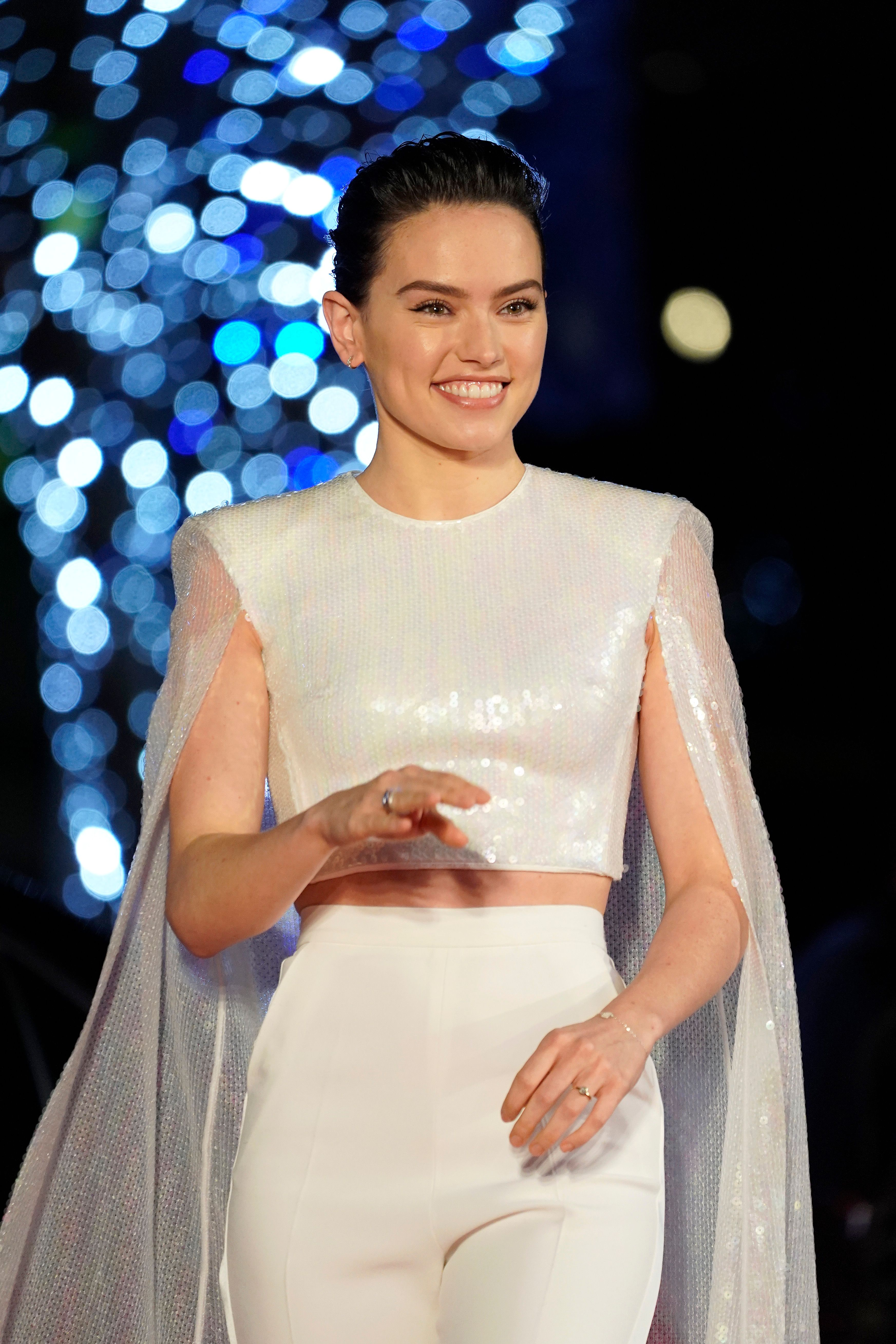 Daisy Ridley in white ensemble at special event