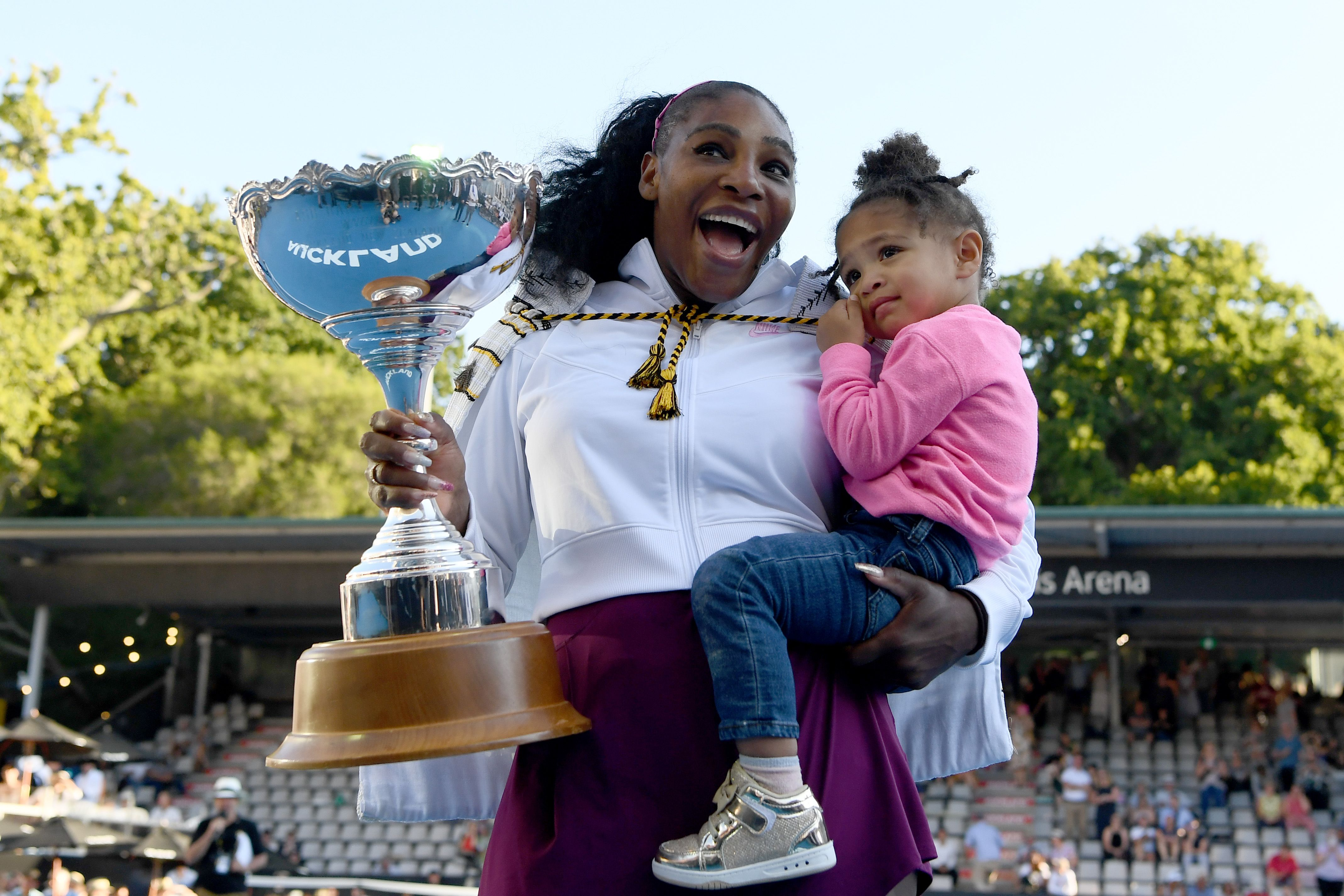 Serena Williams looks incredible with her daughter while holding an award.