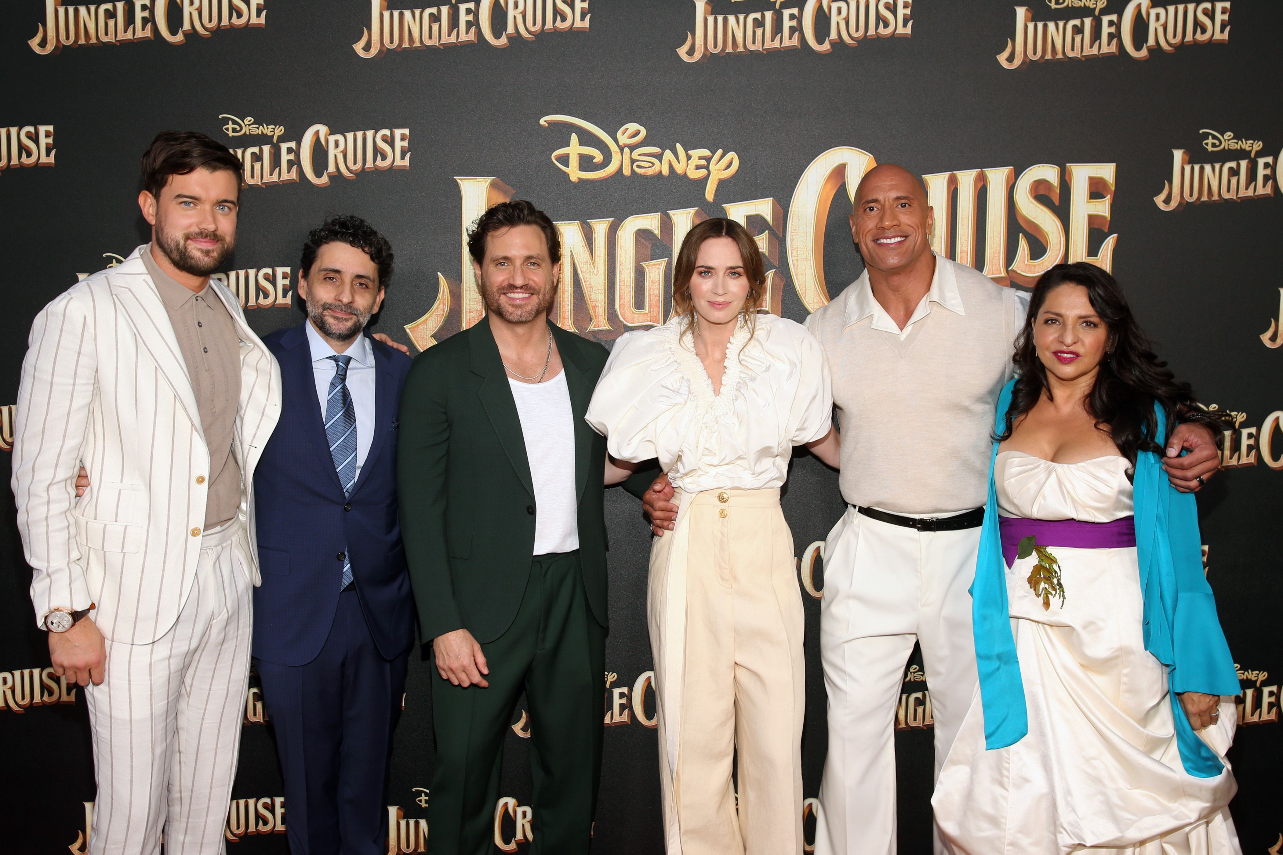 Emily Blunt and Dwayne 'The Rock' Johnson wrap their arms around each other with the 'Jungle Cruise' cast.