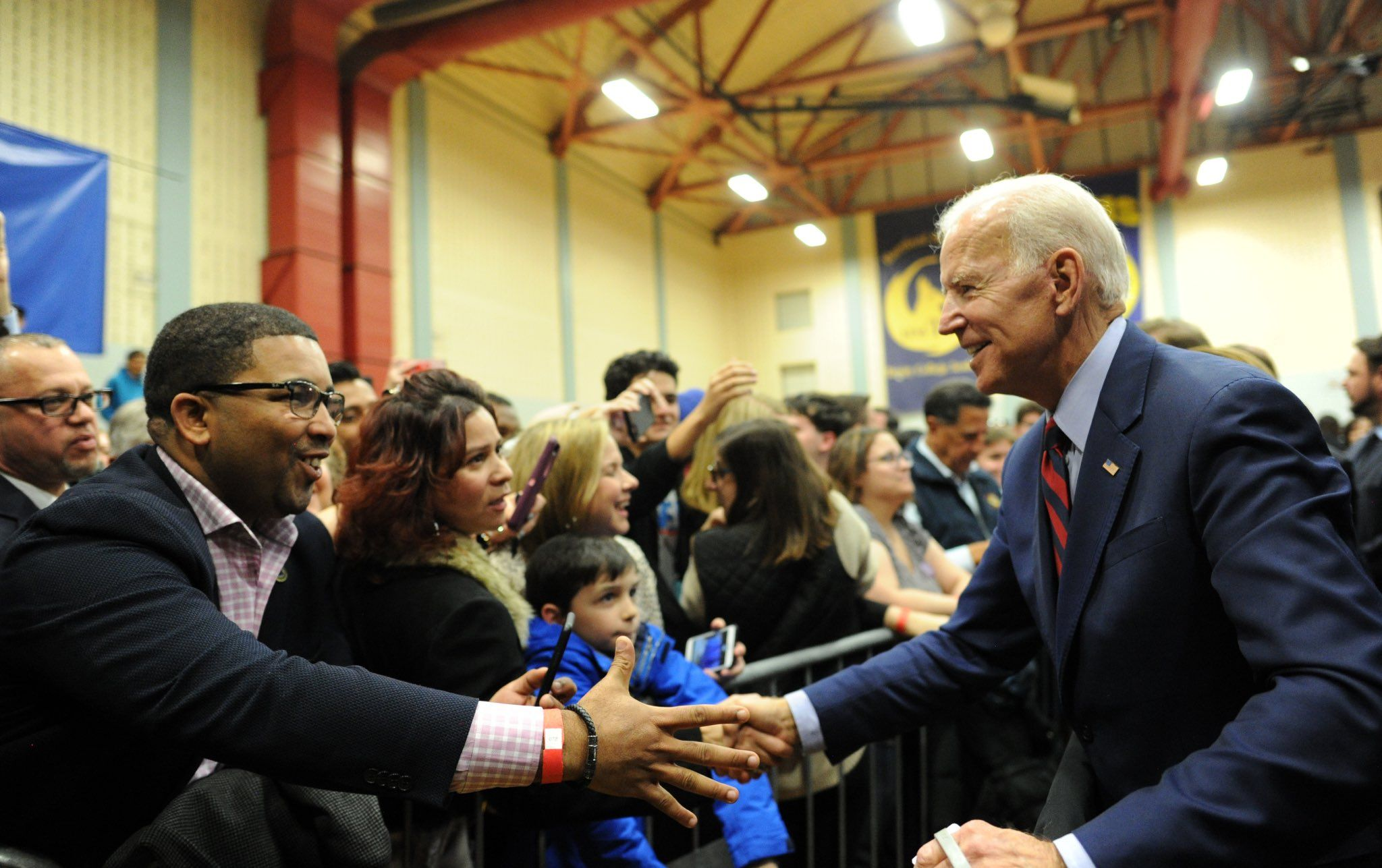 Joe Biden shaking hands with supporters