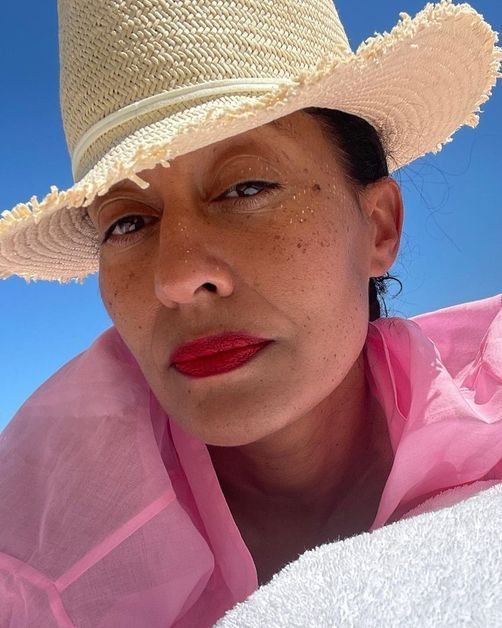 Tracee Ellis Ross wears a bold red lip in a close-up snap.