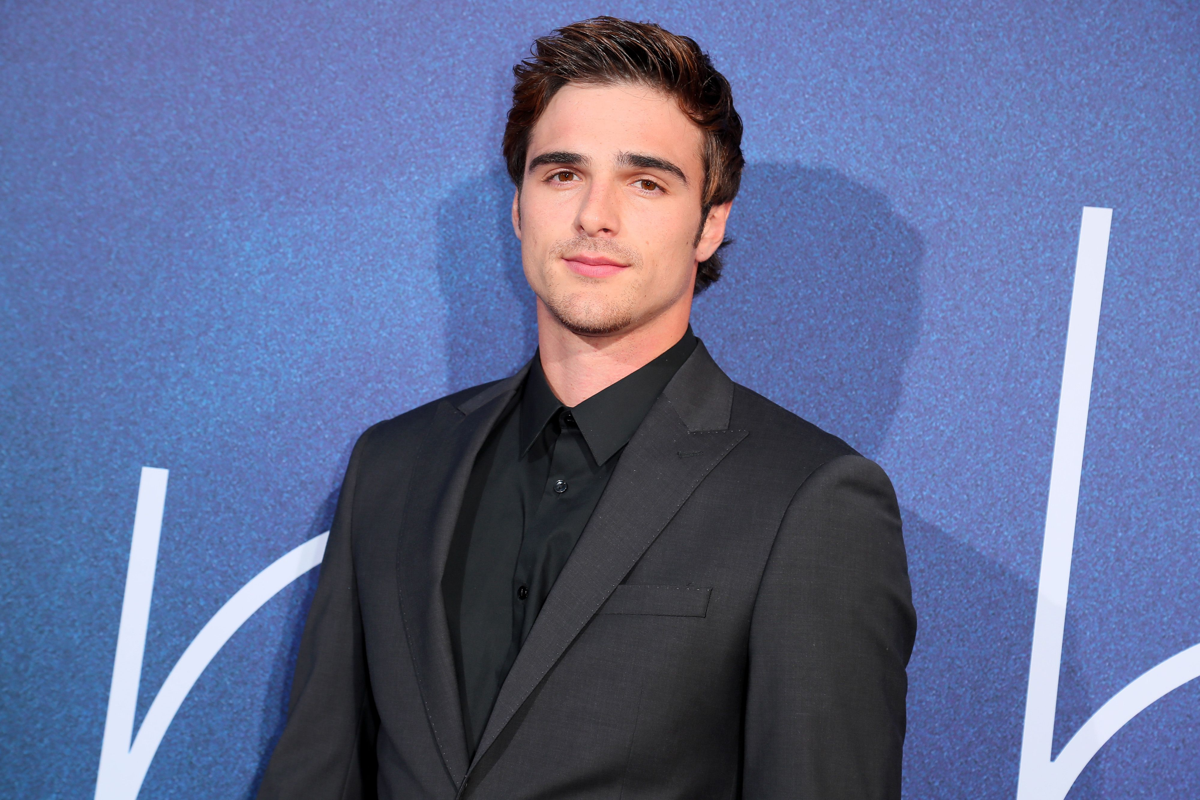 Jacob Elordi wearing a black suit while at an event.