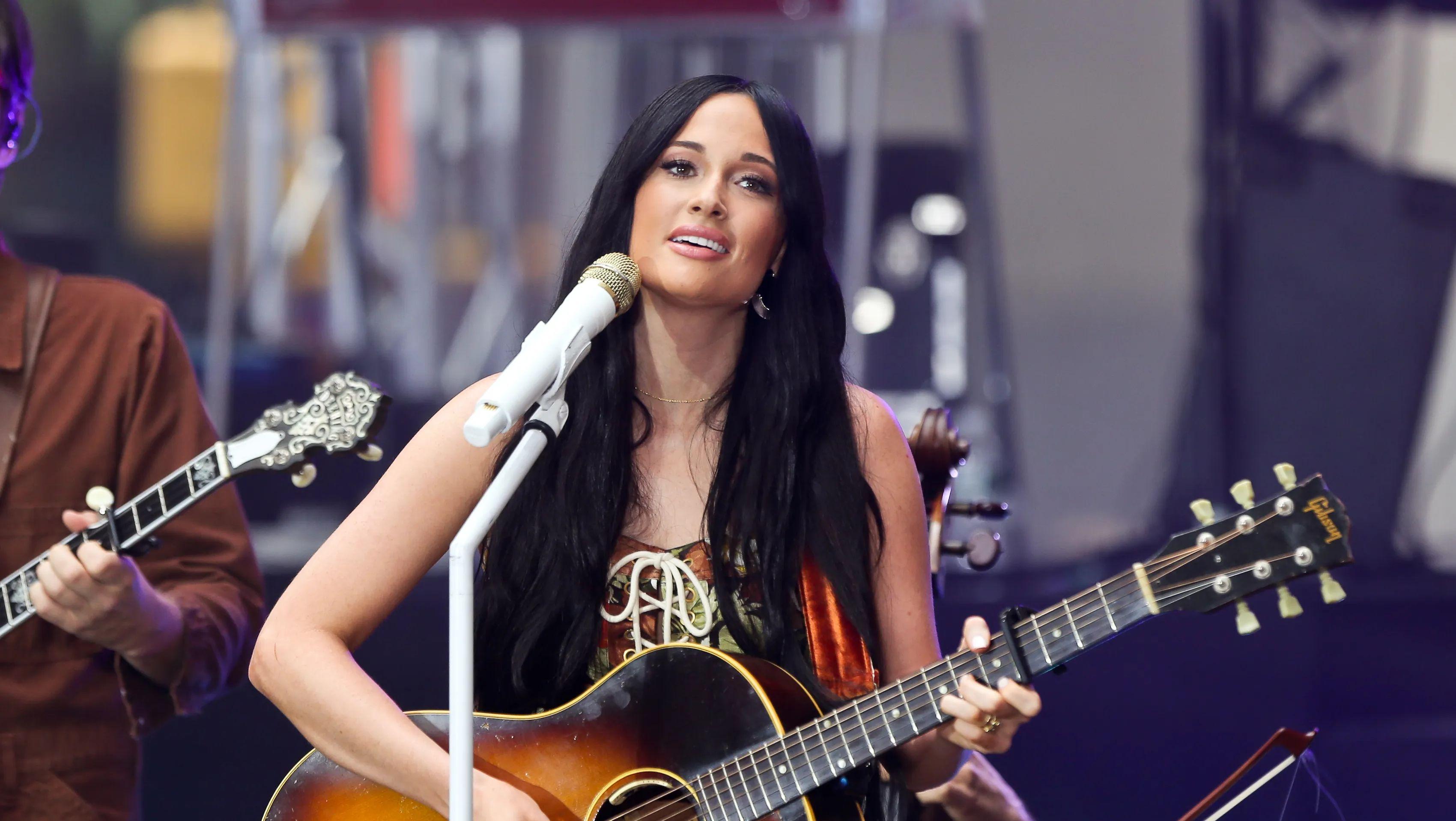 Kacey Musgraves singing and playing guitar