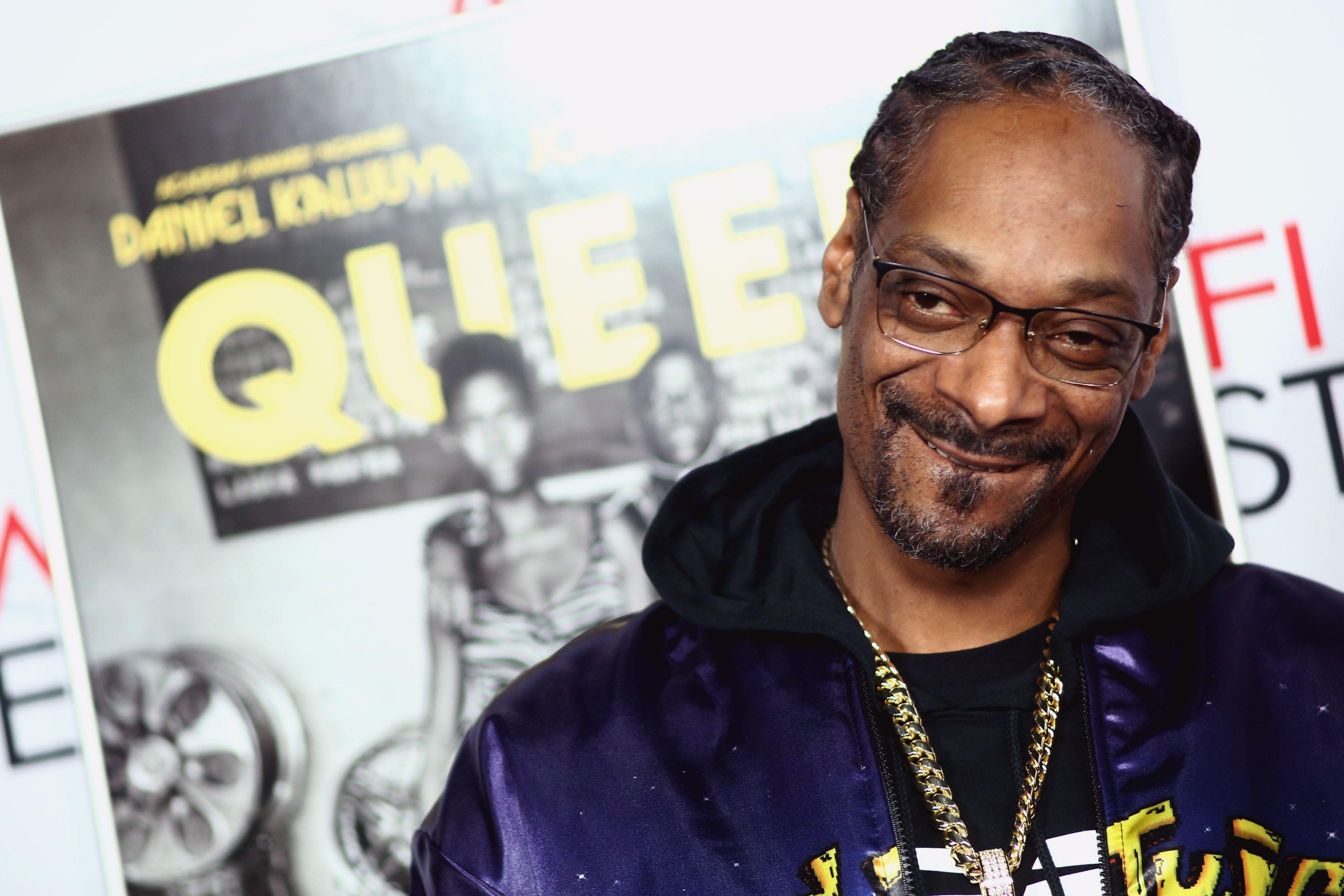 Snoop Dogg headshot, smiling.