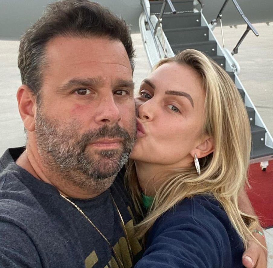 Lala Kent and Randall Emmett pose in front of a private jet.