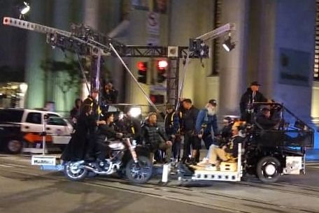 Keanu Reeves and Carrie Ann Moss film a motorcycle scene in the financial district in San Francisco under the direction of Lana Wakowski