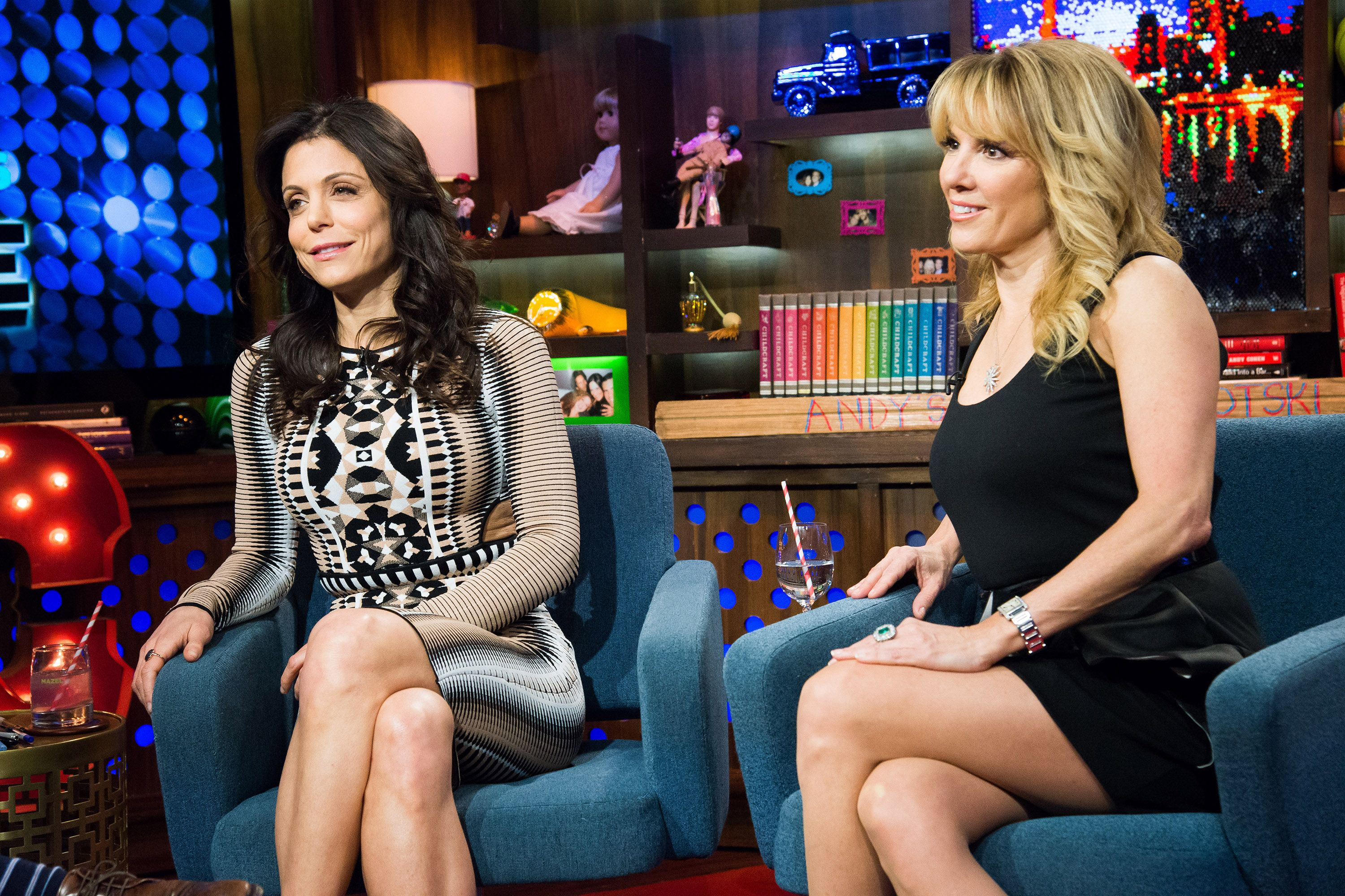 Bethenny Frankel (left) and Ramona Singer (right) sit in armchairs on Watch What Happens Live
