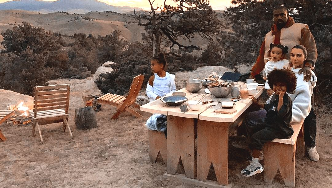 Kanye West and Kim Kardashian enjoy a sunset dinner with their children outside of their Wyoming ranch; September, 2019
