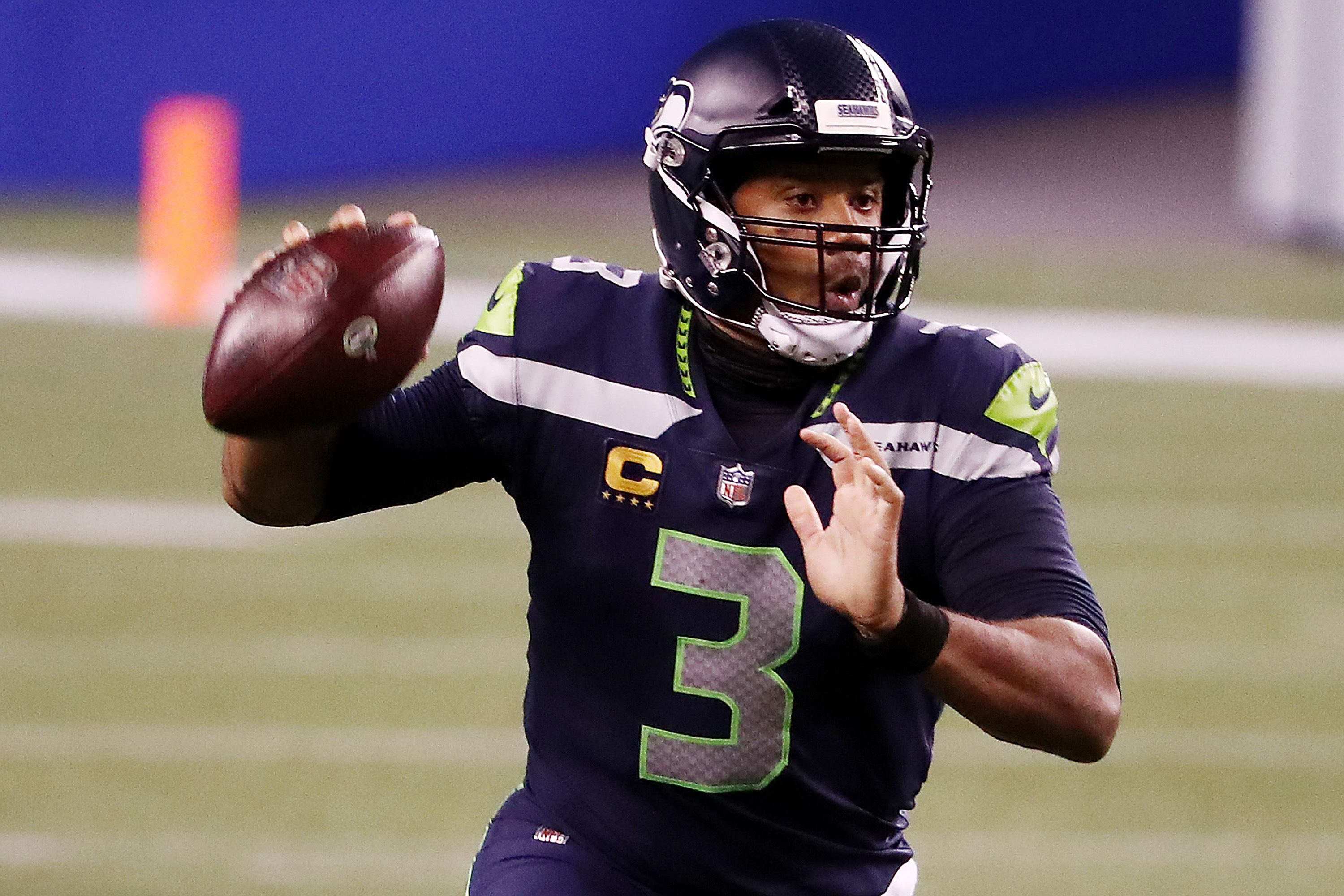 Russell Wilson passing the ball