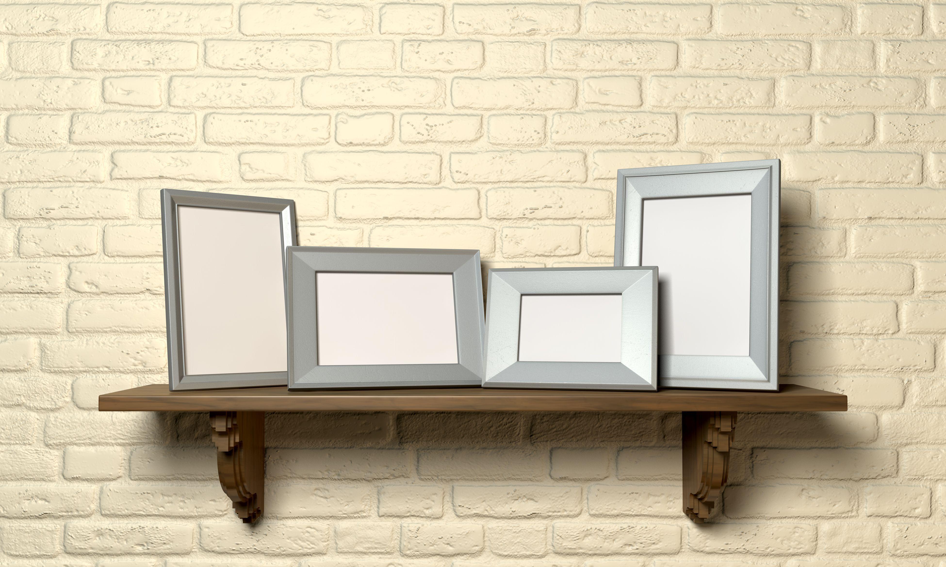 Photo frame ledge mounted on a wall.