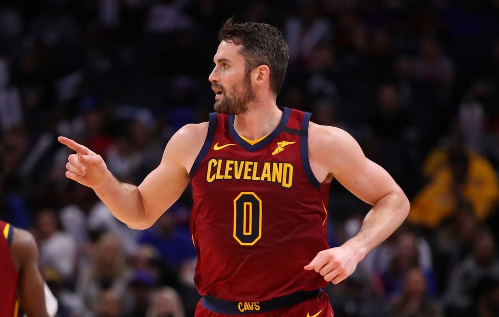 Kevin Love pointing to Cavaliers' bench