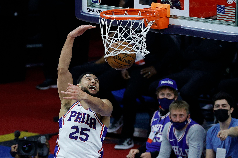 Ben Simmons dunks the ball