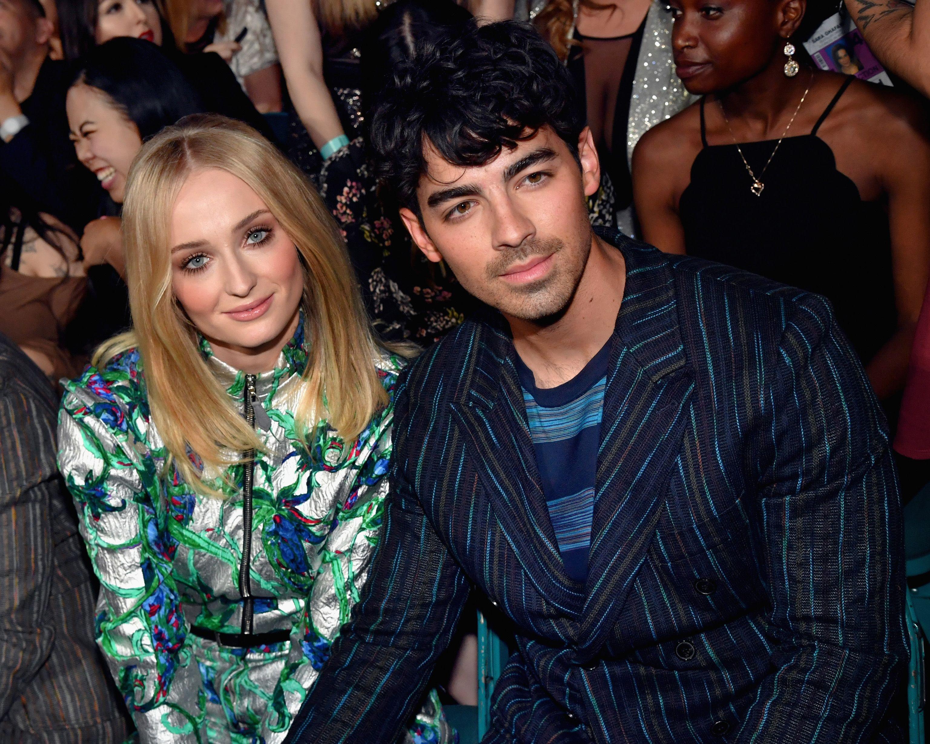 Sophie Turner and Joe Jonas sitting together.