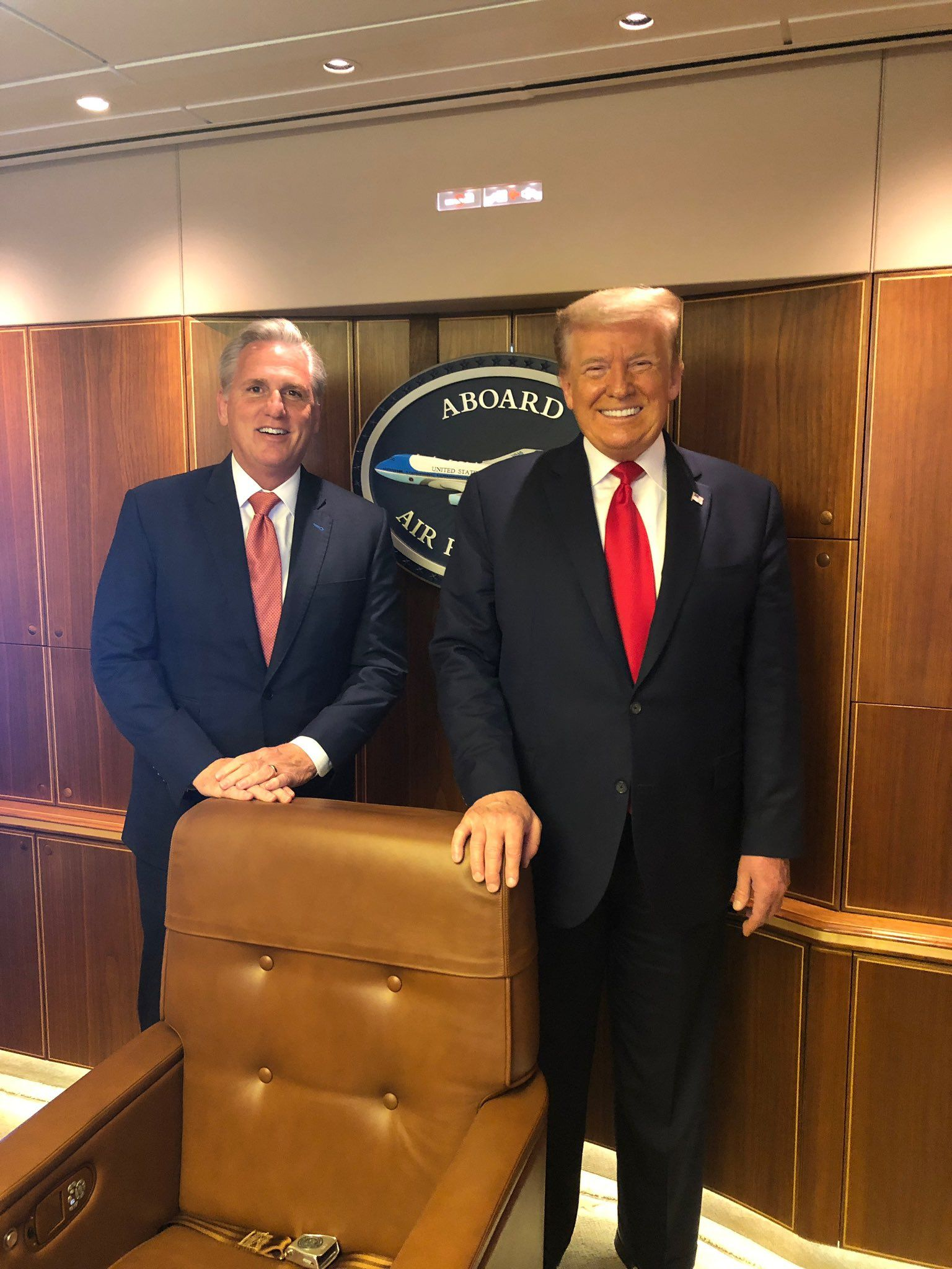 Kevin McCarthy and Donald Trump smiling aboard Air Force One.